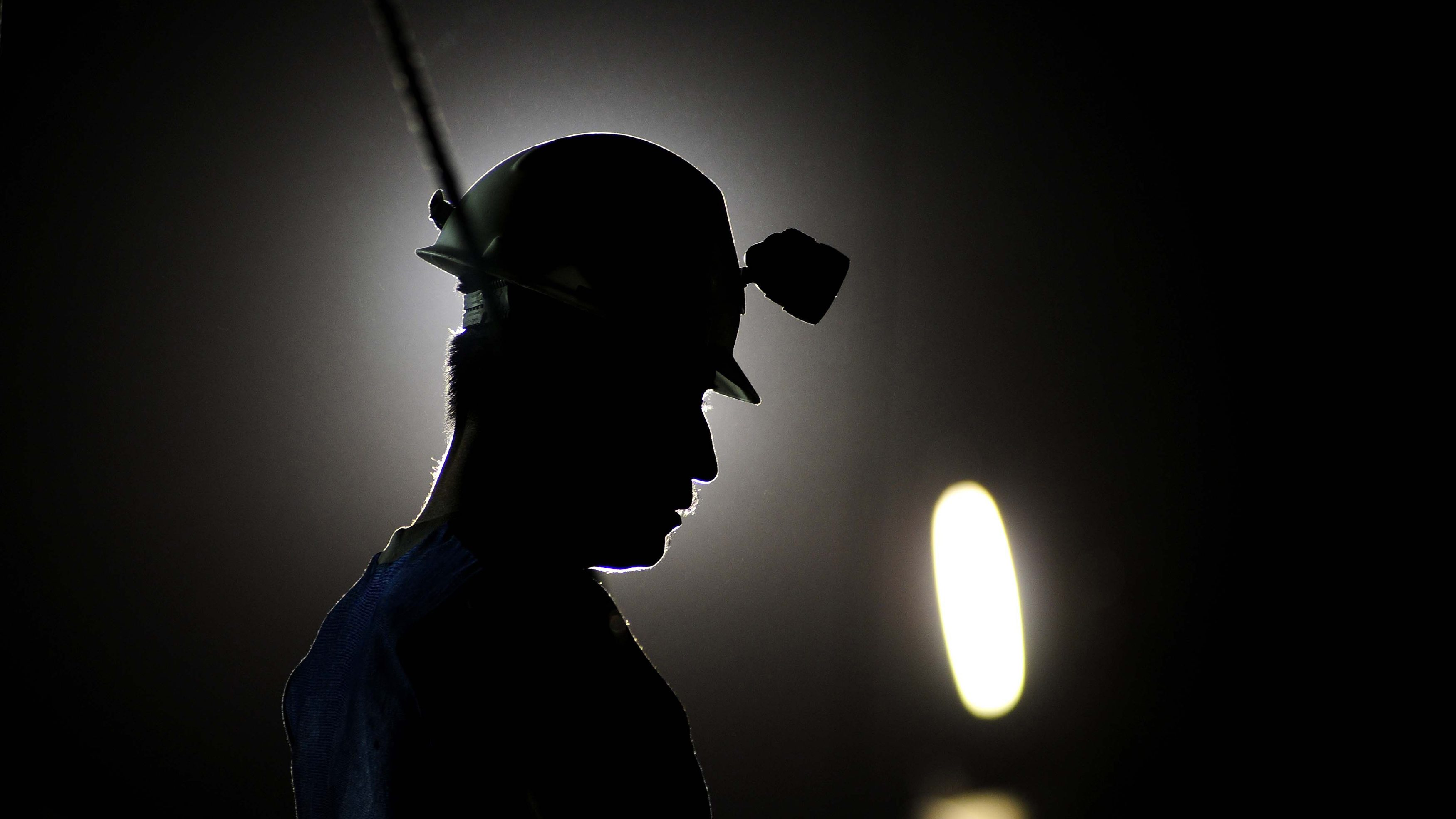 A miner stands near a mine where rescue workers search for trapped colleagues in Sabinas May 3, 2011.  Mexican rescuers searched for nine miners feared dead on Wednesday, a day after a coal mine explosion caused by a build-up of methane gas killed five others, a reminder of dangers facing the thinly regulated industry. Picture taken May 3, 2011