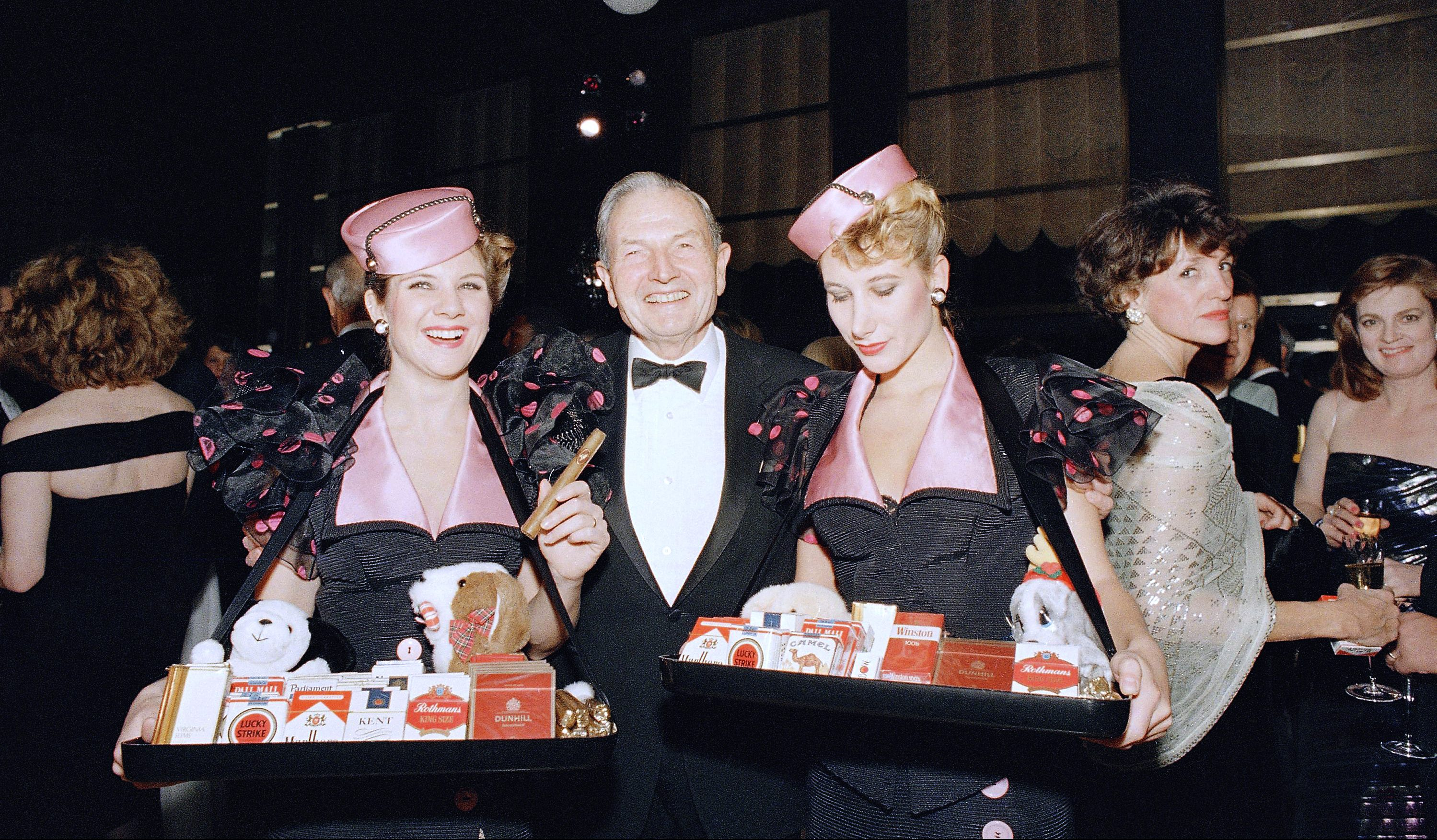 David Rockefeller is joined by cigarette girls at the gala  bash to celebrate the re-opening of the Rainbow Room in Rockefeller Center, New York on Wednesday, Dec. 10, 1987.   The night club renovation, costing $20 million and lasting two years, was done to the style of the 1930s  when the club was in its heyday.
