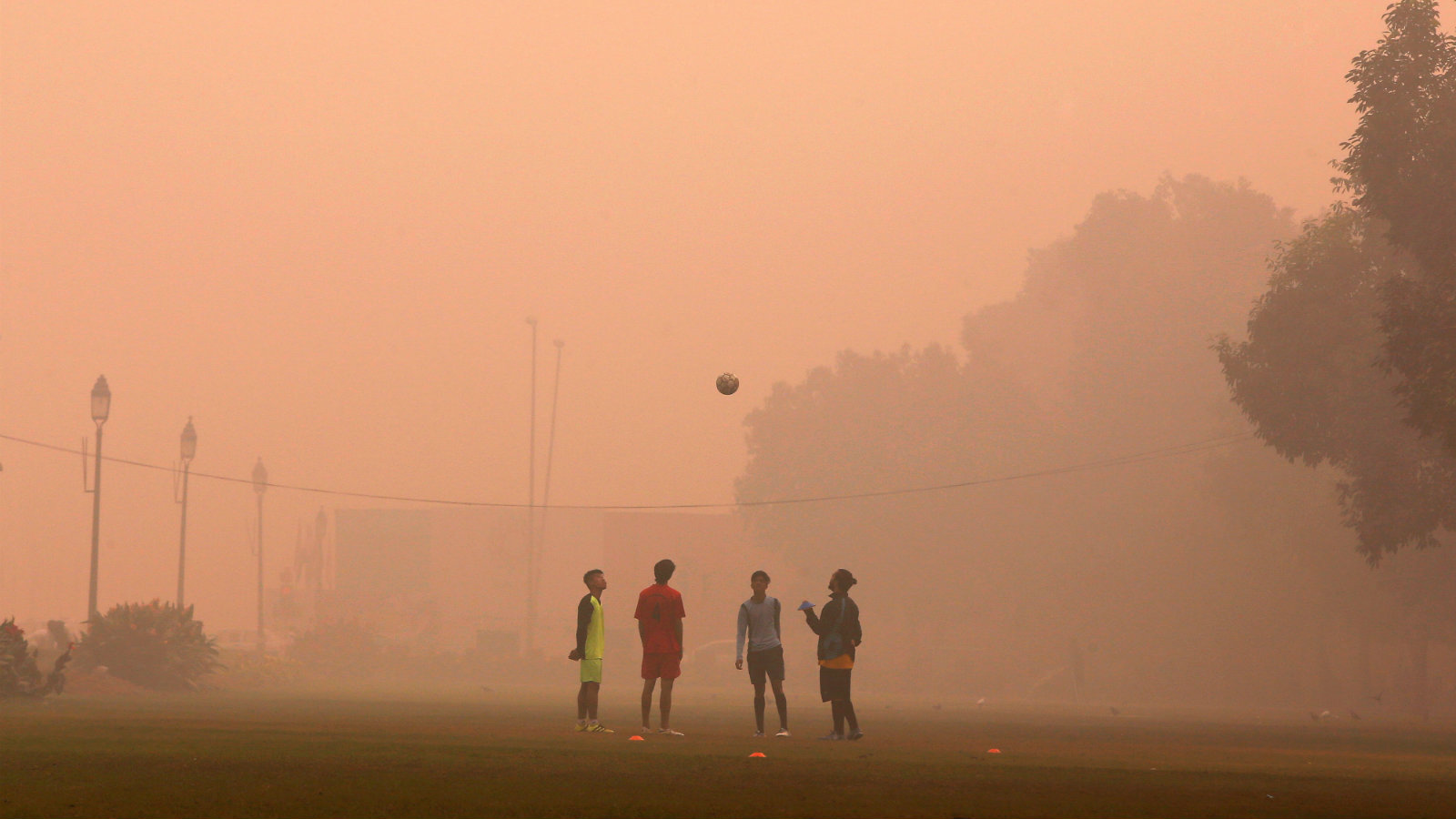 Boys play football in a public park on a smoggy morning in New Delhi, India, November 2, 2016.