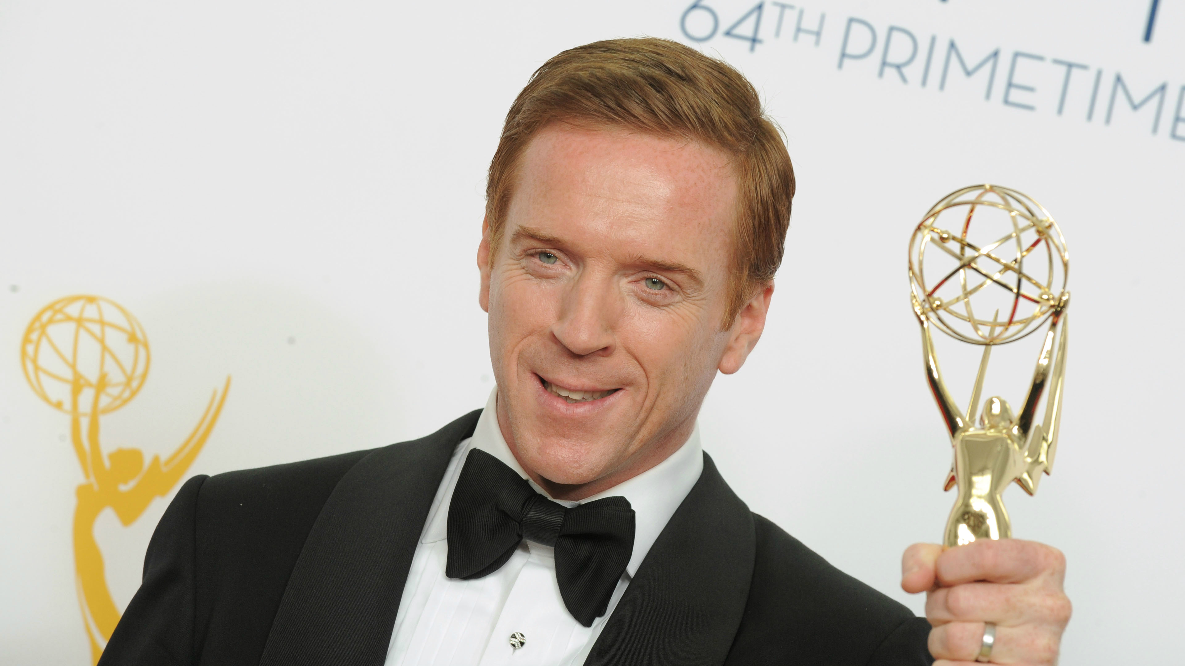 The actor Damien Lewis with an Emmy in 2012.