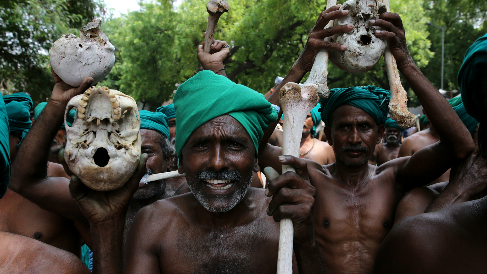 Indian farmers from South Indian Rivers Interlinking Farmers Association hold skulls claiming they belong to farmers who died in the past in Tamil Nadu, during a protest in New Delhi, India, 18 July 2017. Around 50 farmers have resumed their protest as they are demanding the formation of Cauvery river management committee and networking for all rivers by smart waterways project and are demanding better rate for their crops.