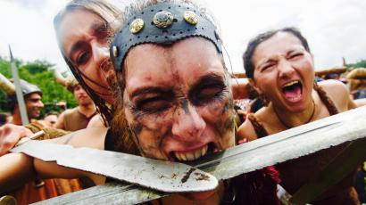 Women dressed as Vikings take part in the annual Viking festival of Catoira in Spain.