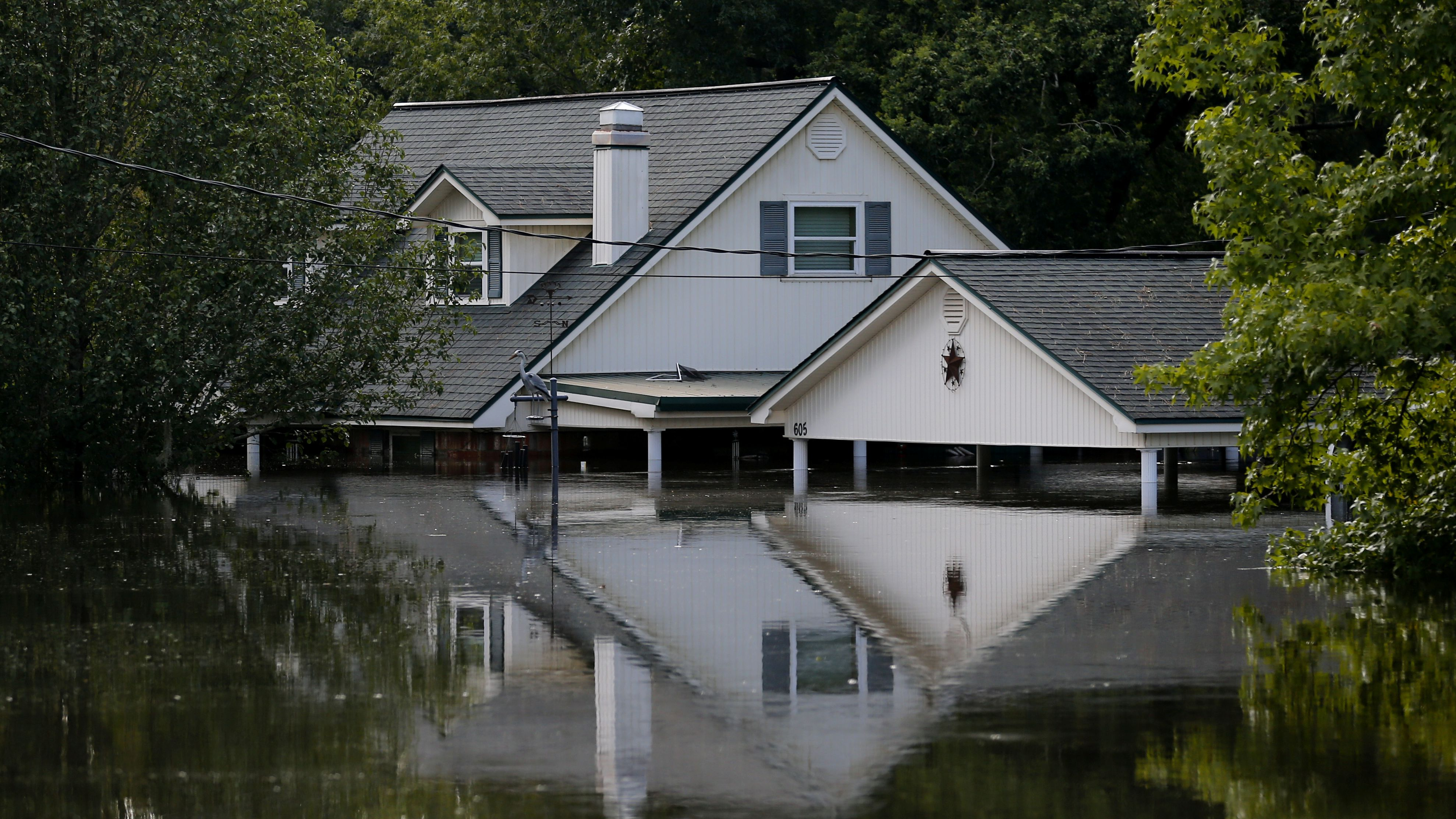 A submerged house by flood waters from Tropical Storm Harvey in Rose City, Texas, U.S., on August 31, 2017.