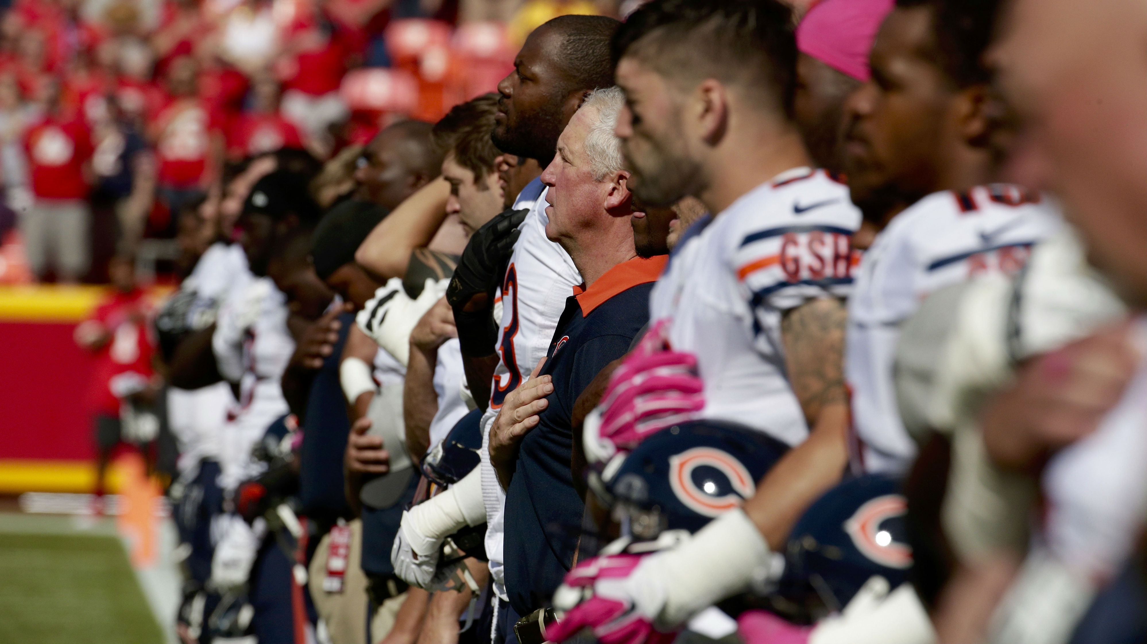 Chicago Bears head coach John Fox stands with his players during the singing of the Star Spangled Banner before an NFL football game between the Kansas City Chiefs and the Chicago Bears in Kansas City, Mo., Sunday, Oct. 11, 2015. (AP Photo/Charlie Riedel)