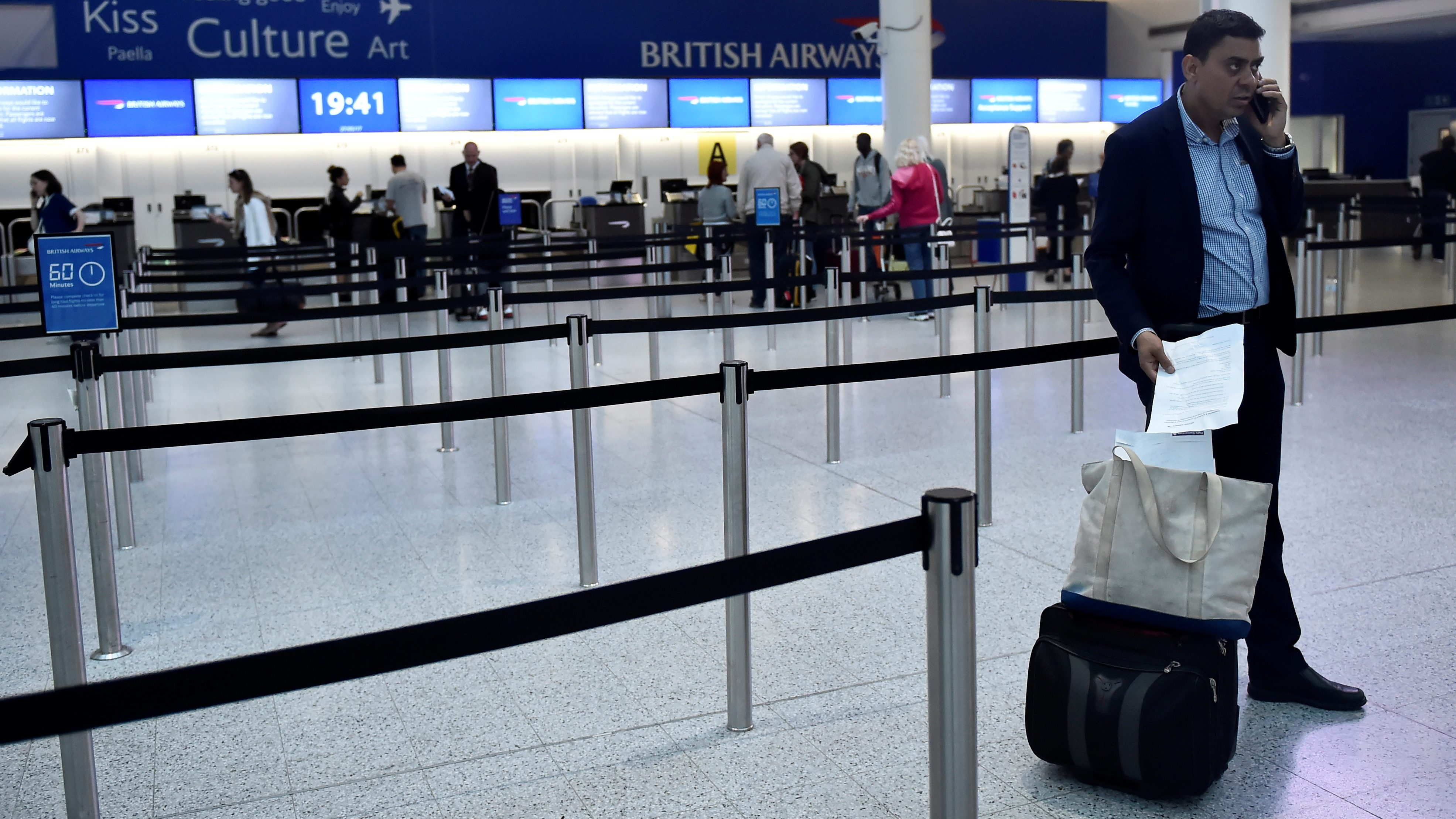 A man waits with his luggage at Gatwick Airport in southern England, Britain, May 27, 2017.