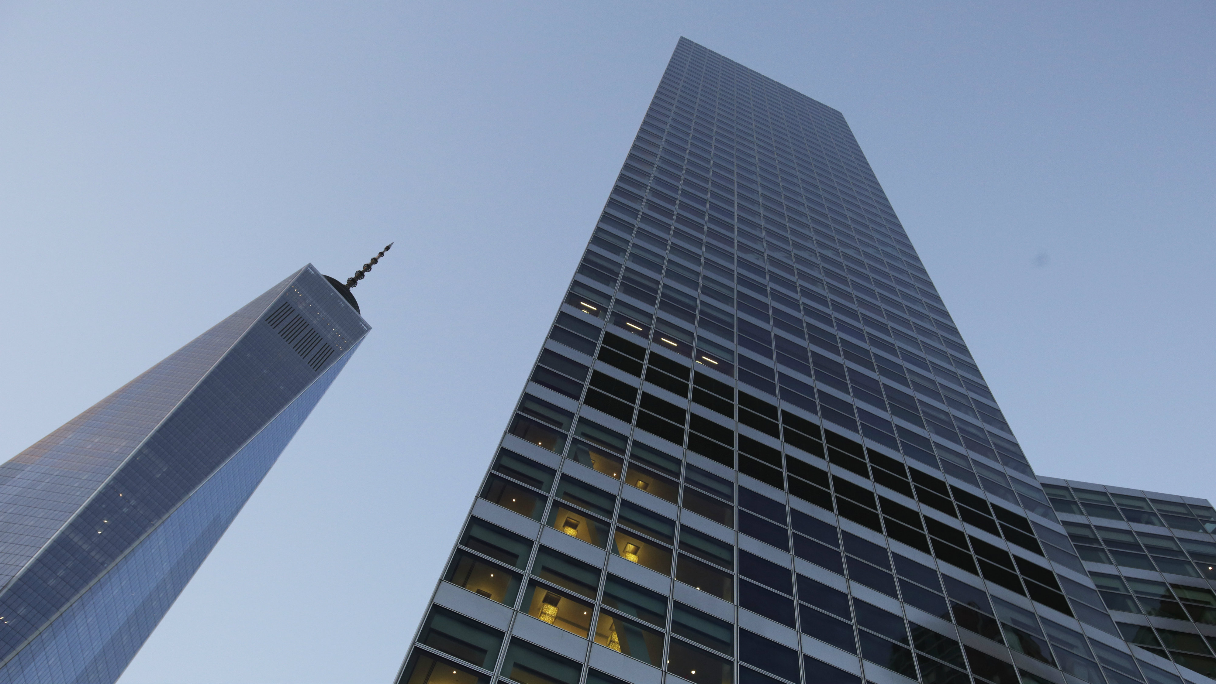 In this Thursday, Oct. 15, 2015, file photo, Goldman Sachs headquarters, right, neighbors One World Trade Center, in New York. Goldman Sachs, the most Wall Street of Wall Street firms, is pushing quietly into the realm of consumer banking.