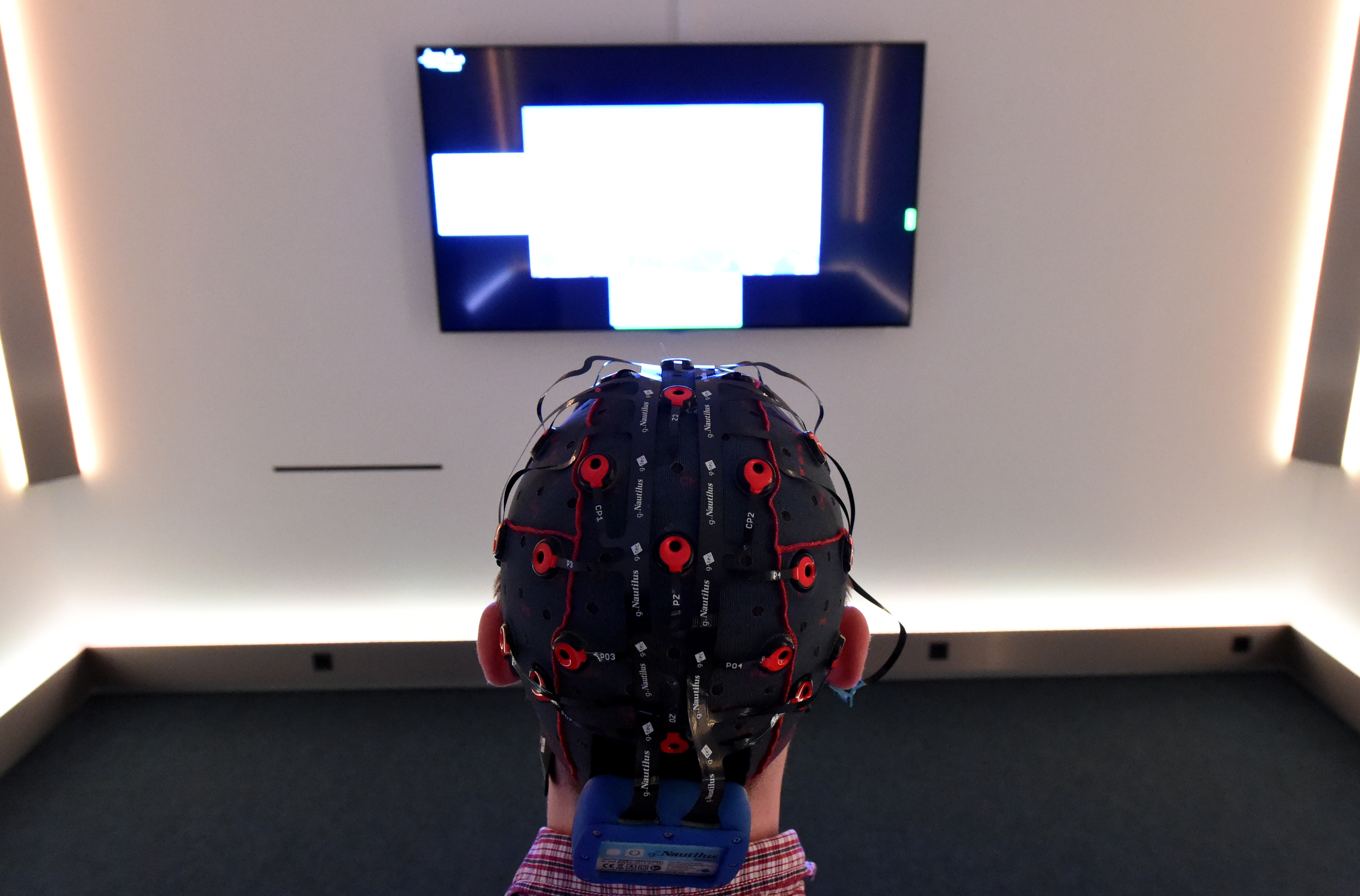Researcher Jens Reermann wearing a brain-computer interface allowing him to control pictures on a screen with his brain, at Christian-Albrechts-Universitaet in Kiel, Germany, 19 February 2015.