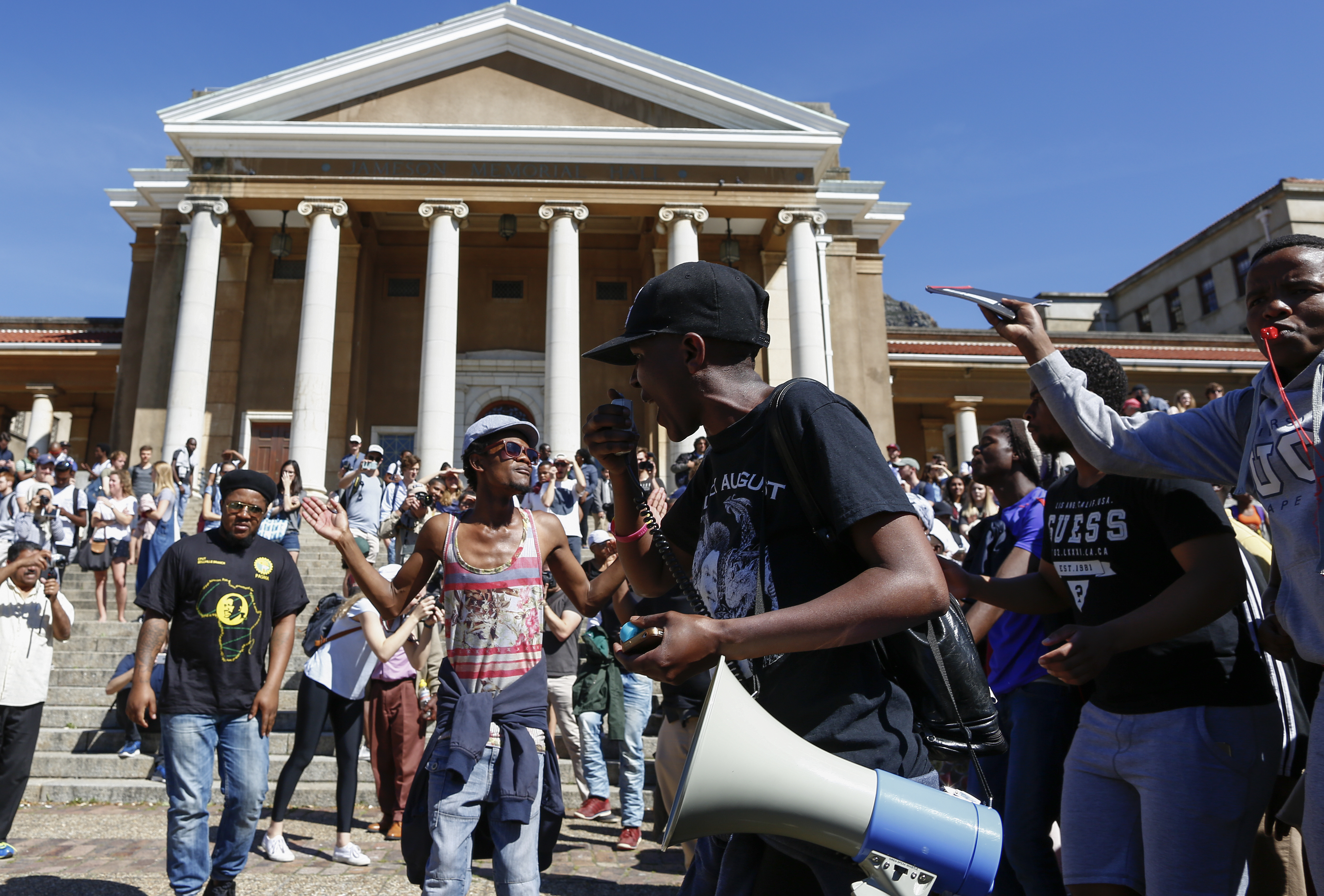 epa05568149 Students protest in support of the #FeesMustFall campaign ahead of disrupting lectures and the normal functioning of campus at the University of Cape Town (UCT) in Cape Town, South Africa, 03 October 2016. The small group of protesters  managed to shut down several lectures and disrupt the majority of students who wish to complete the year. Protests against tuition fees continued at universities across the country.  EPA/NIC BOTHMA