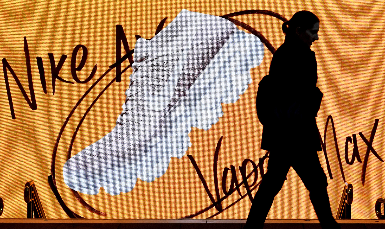 epa06064547 A pedestrian walks past a Nike advertisement in Pitt Street Mall in Sydney, New South Wales, Australia, 04 July 2017. EPA/MICK TSIKAS AUSTRALIA AND NEW ZEALAND OUT