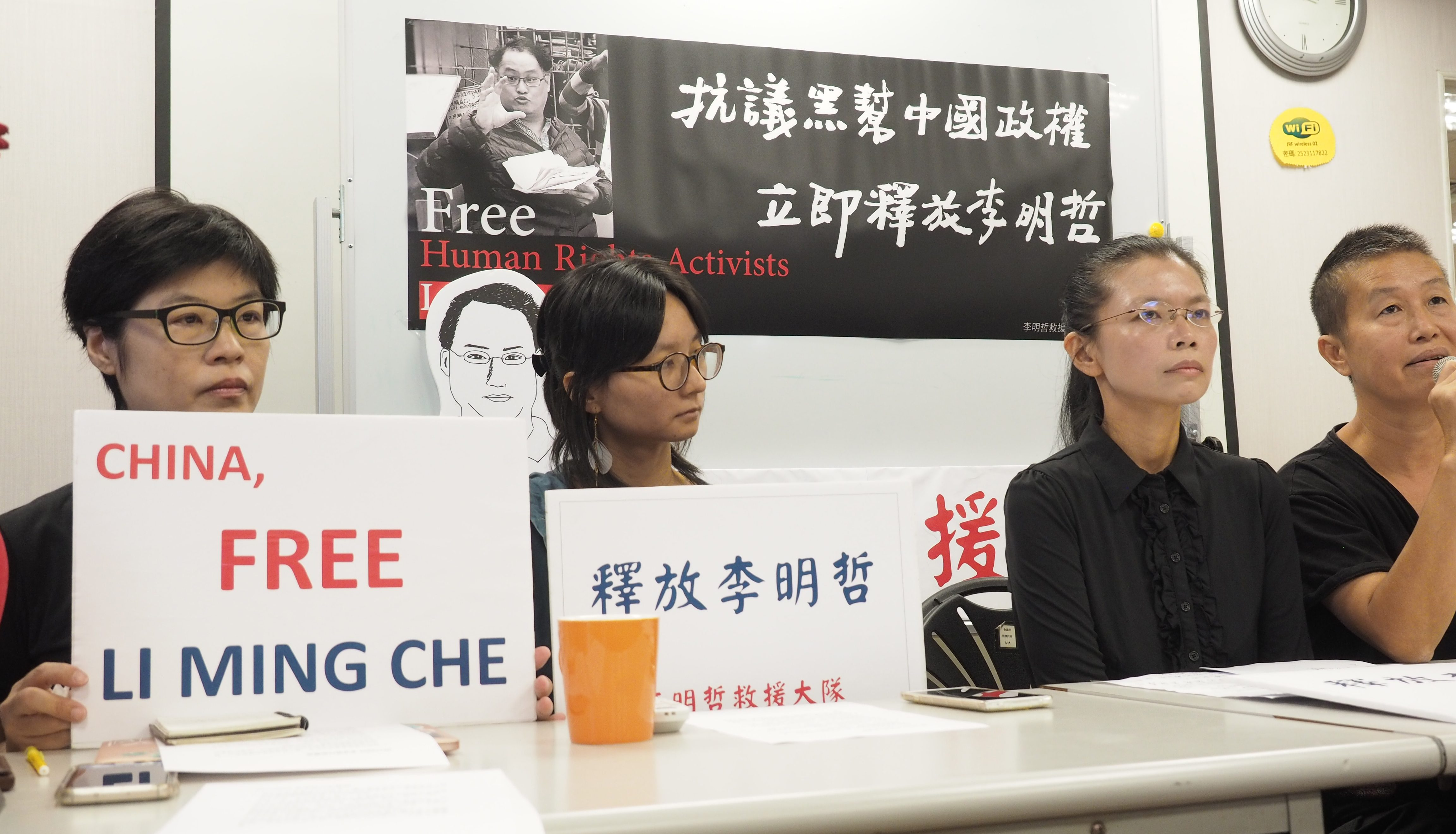Taiwanese activist pleads guilty in Chinese court, but wife insists he is innocent
