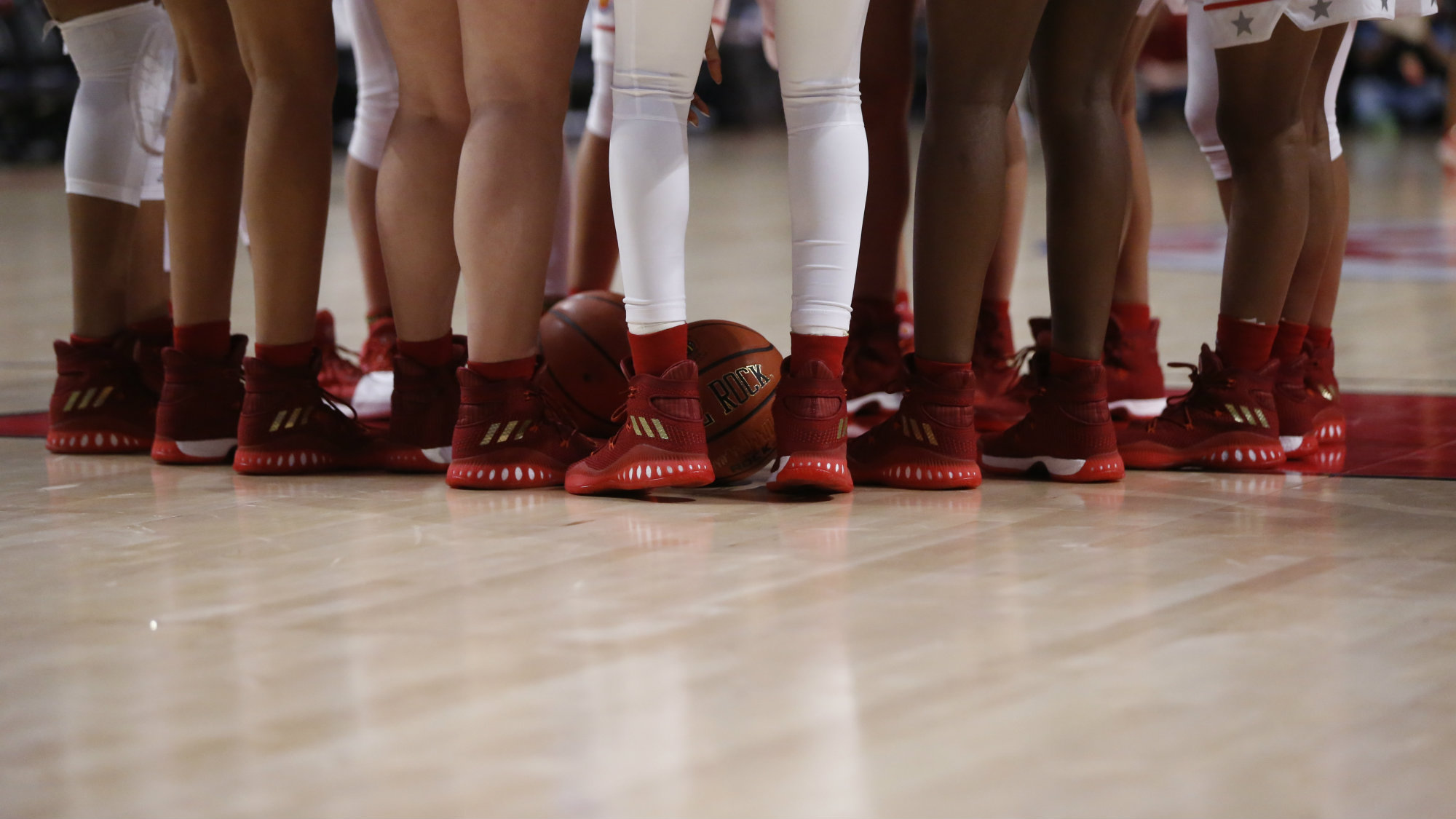 The girls Big West's basketball team huddle before their game against the Big East's team wearing their Adidas shoes during the first half of the McDonald's All-American girls basketball game Wednesday, March 29, 2017, in Chicago.