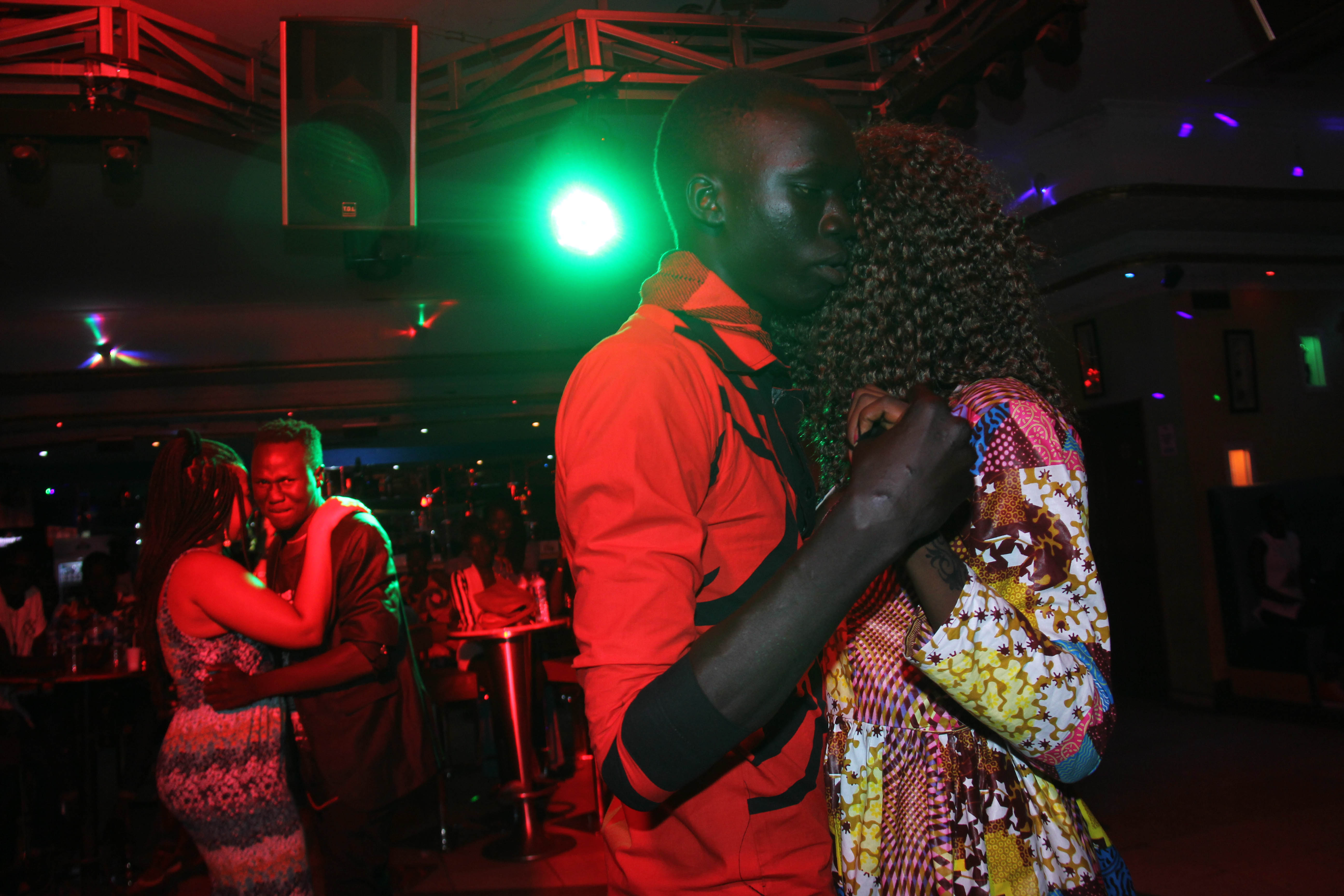 "A couple dances at a ""day club"" in Juba, South Sudan."