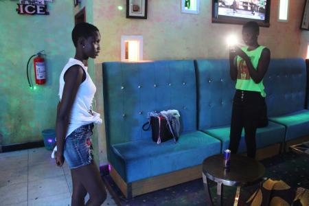 Women posing for photos during a day party at Club Signature in Juba, South Sudan.