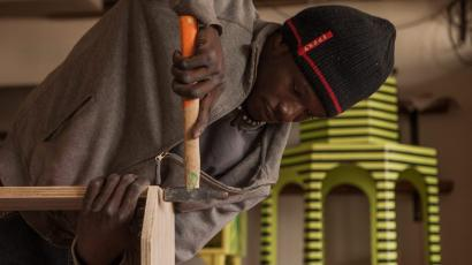 man building house