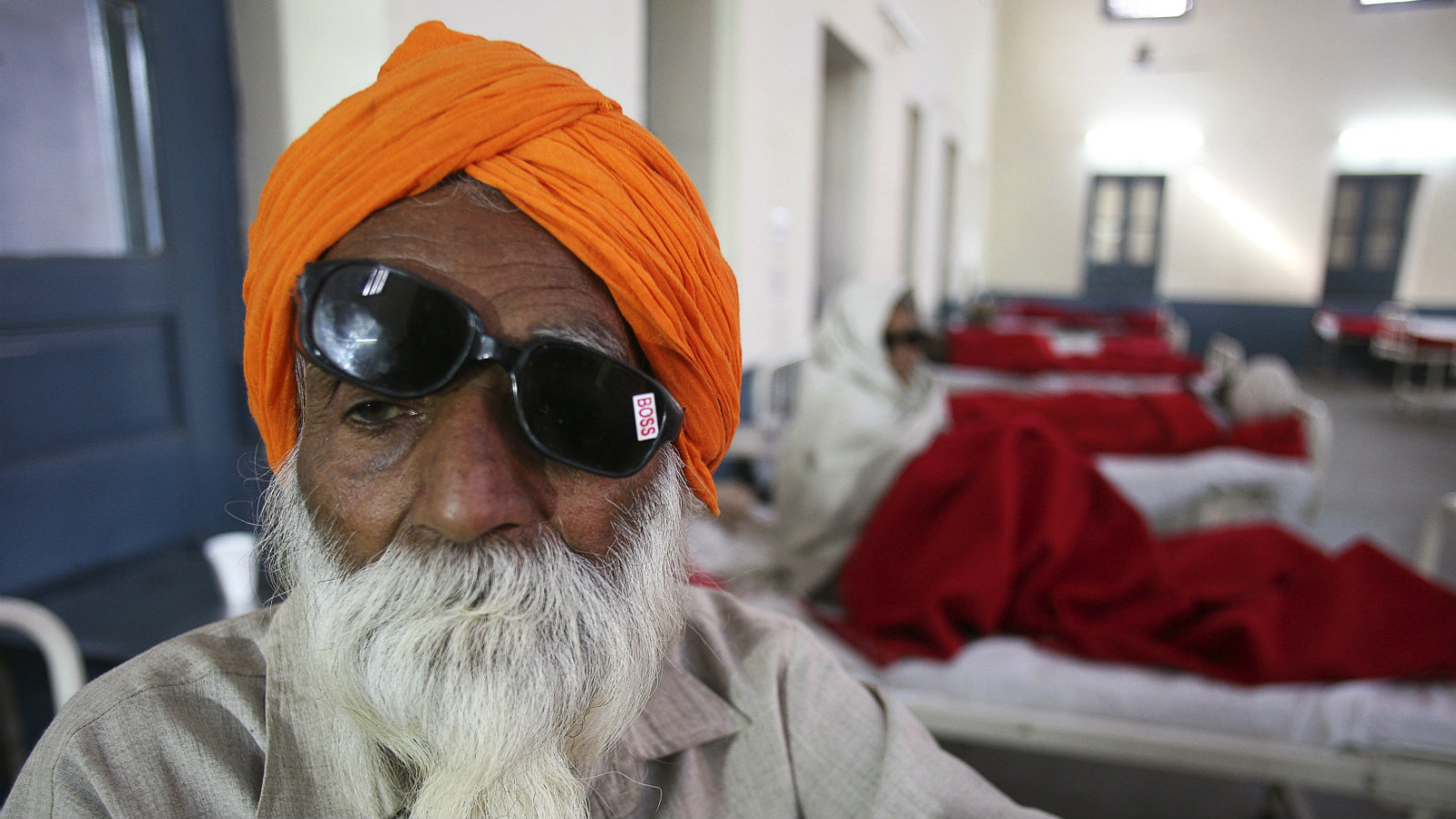 A man sits on a bed while waiting for treatment at a hospital after undergoing cataract removals from a free eye surgery camp, in the northern Indian city of Amritsar December 5, 2014. Fifteen Indians lost their sight after a doctor used suspected infected equipment to remove cataracts at the free eye surgery camp, the latest incident to highlight the dangers of shoddy medical treatment in the country. A criminal investigation has been launched against the non-governmental organization and the doctors who carried out the operations, mainly on elderly women, without consulting health authorities.