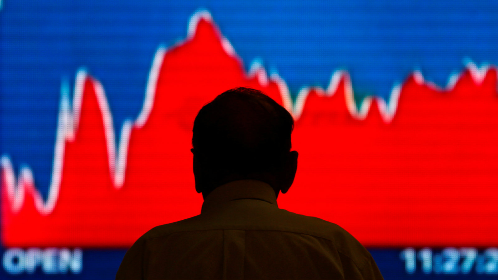 A man looks at a screen displaying news of markets update inside the Bombay Stock Exchange (BSE) building in Mumbai, India June 20, 2016.