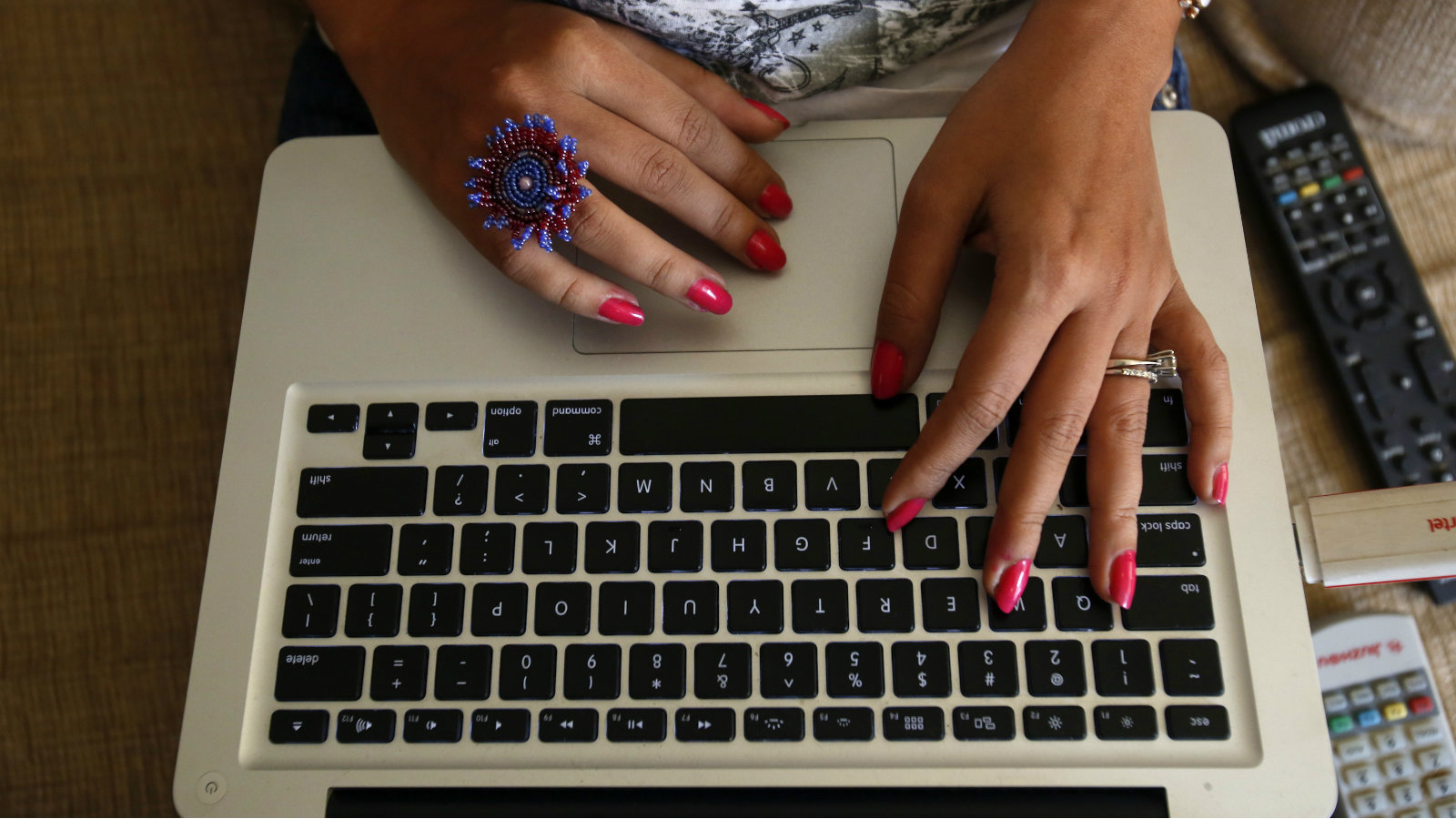 "The hands of Malini Agarwal, blogger-in-chief of missmalini.com, are pictured as she blogs from her living room in Mumbai, January 22, 2013. Agarwal, 35, exemplifies what aspirational India is all about - She's bubbly, energetic, and describes herself as ""India's blogging princess"" and a ""social media Jedi"". She's been called ""without a doubt, India's most famous blogger"". Her blog, missmalini.com, gets over 250,000 unique visitors a month. It provides a steady diet of Bollywood gossip, fashion, food and entertainment to a legion of followers."