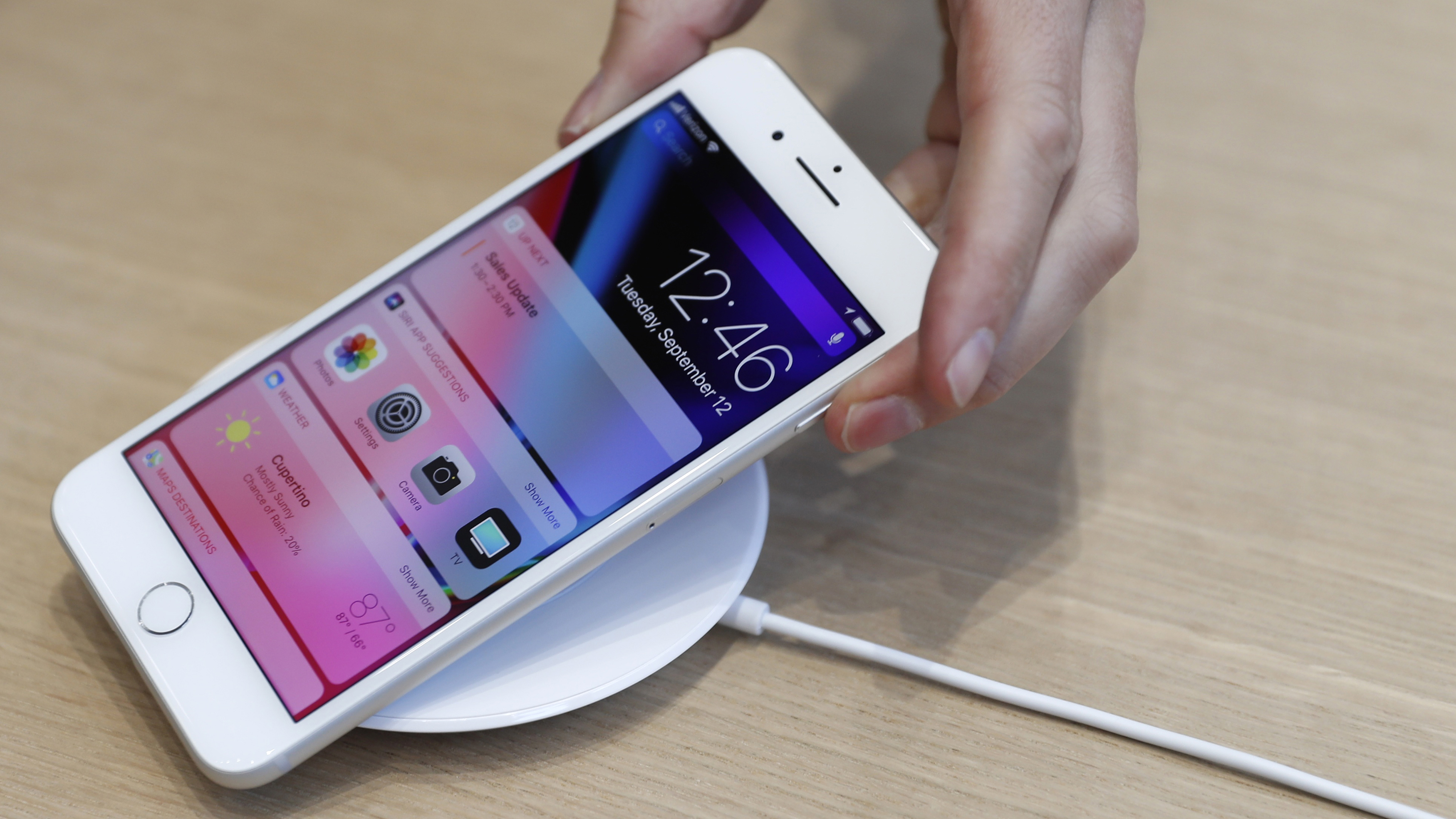 An AirPower wireless charger is displayed during a launch event in Cupertino