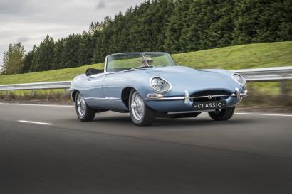 Jaguar E-type Zero being driven on the road.