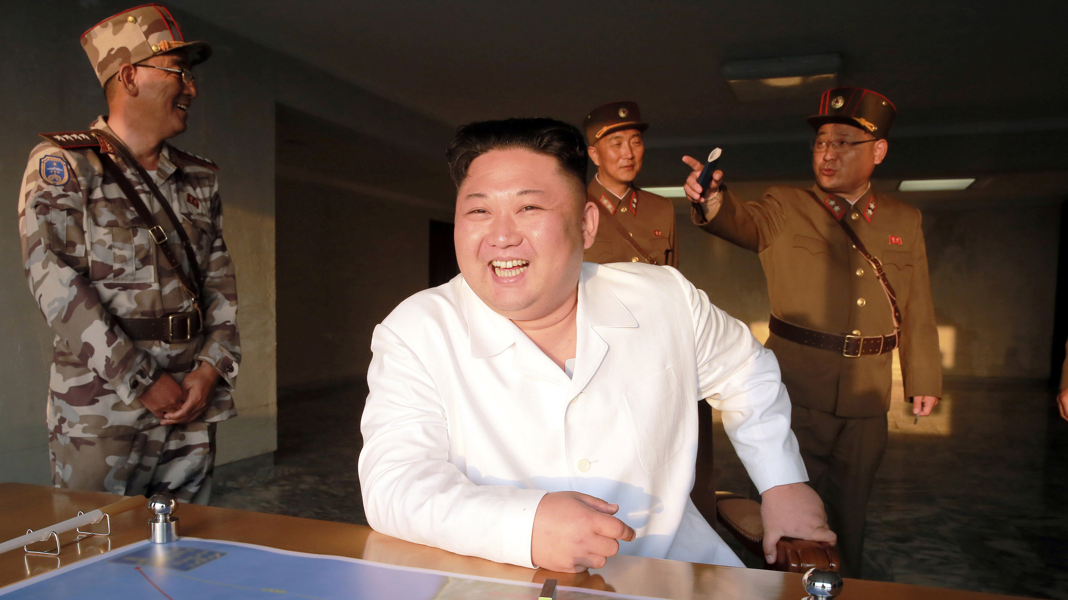 North Korean leader Kim Jong Un reacts during a ballistic rocket test-fire through a precision control guidance system in this undated photo released by North Korea's Korean Central News Agency (KCNA) May 30, 2017.