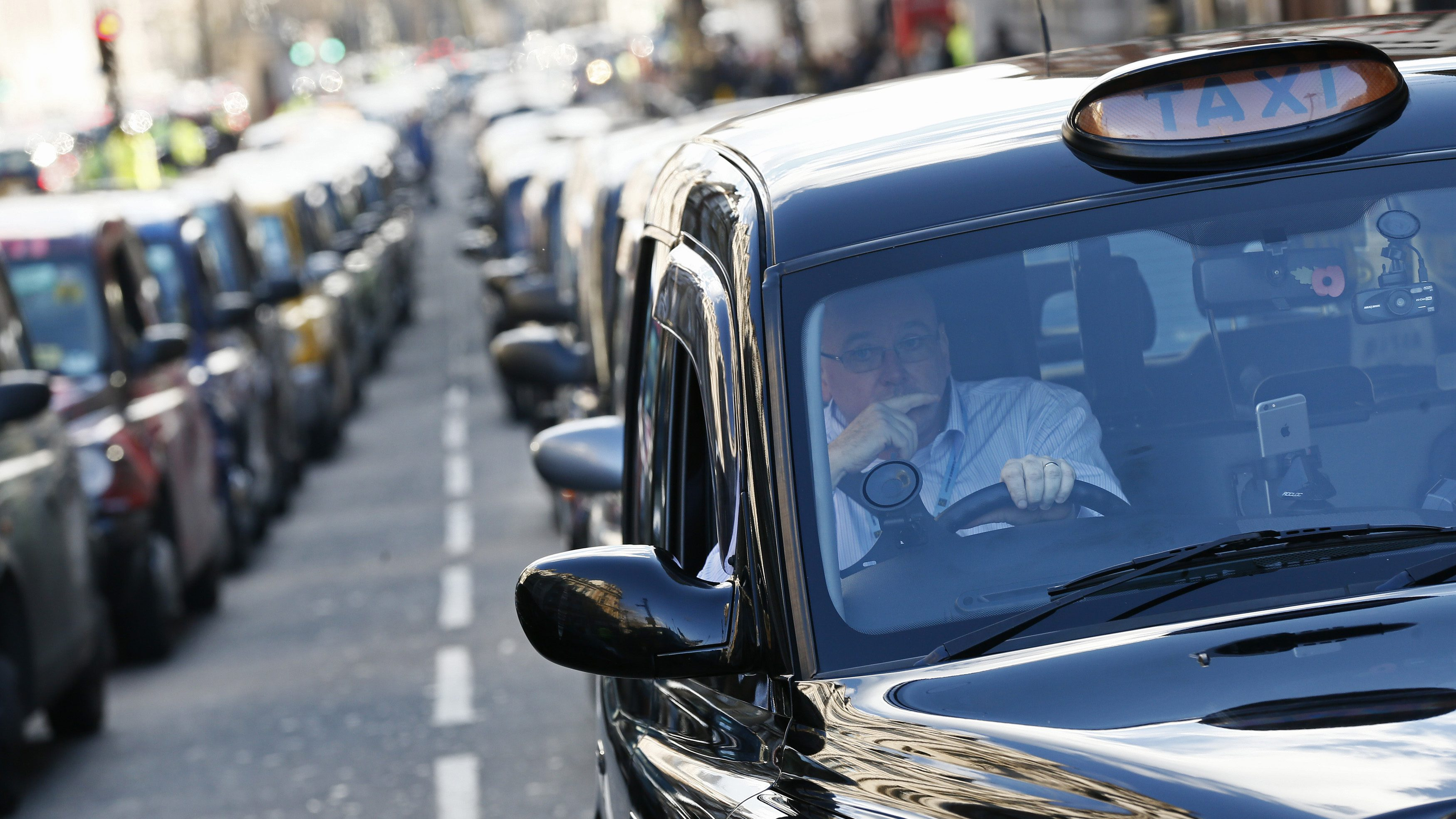 London cab drivers protest against Uber in central London