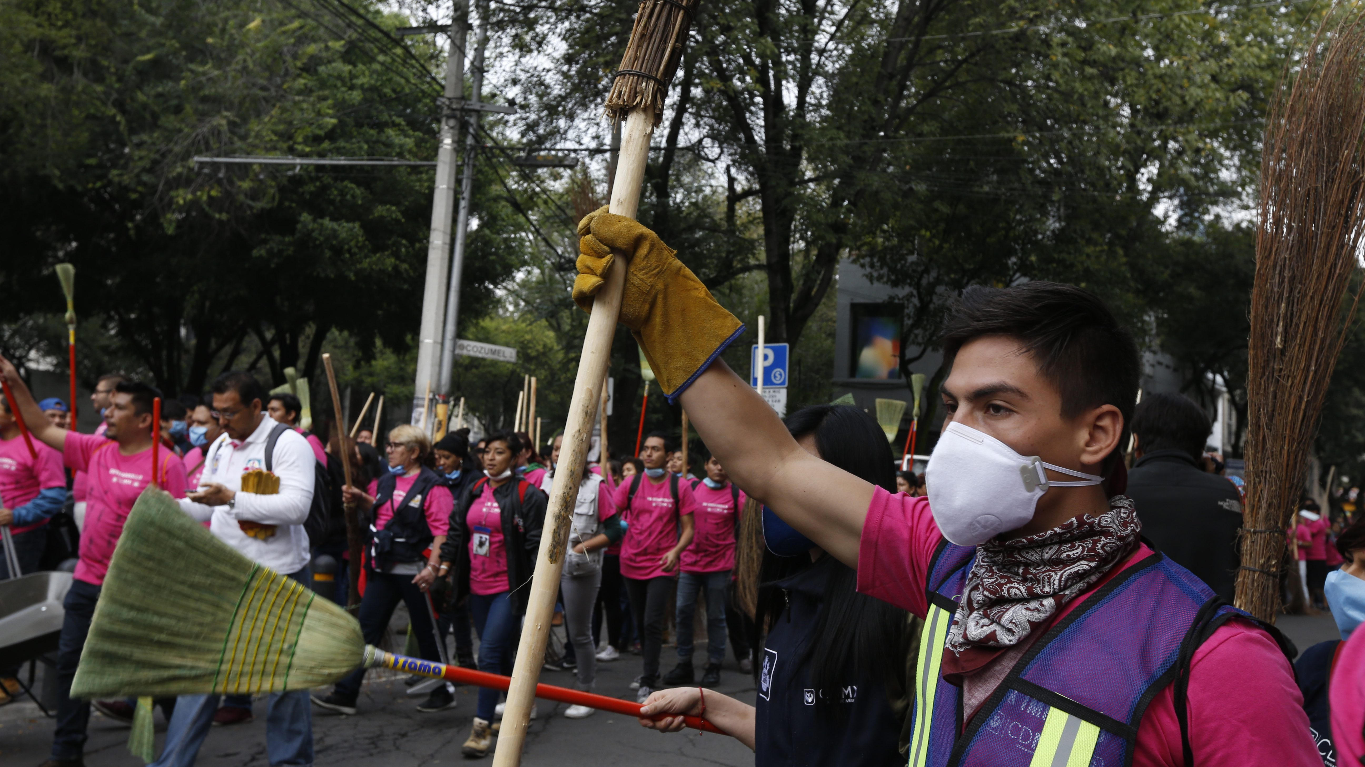volunteers cheer before getting to work cleaning after Mexico City earthquake.
