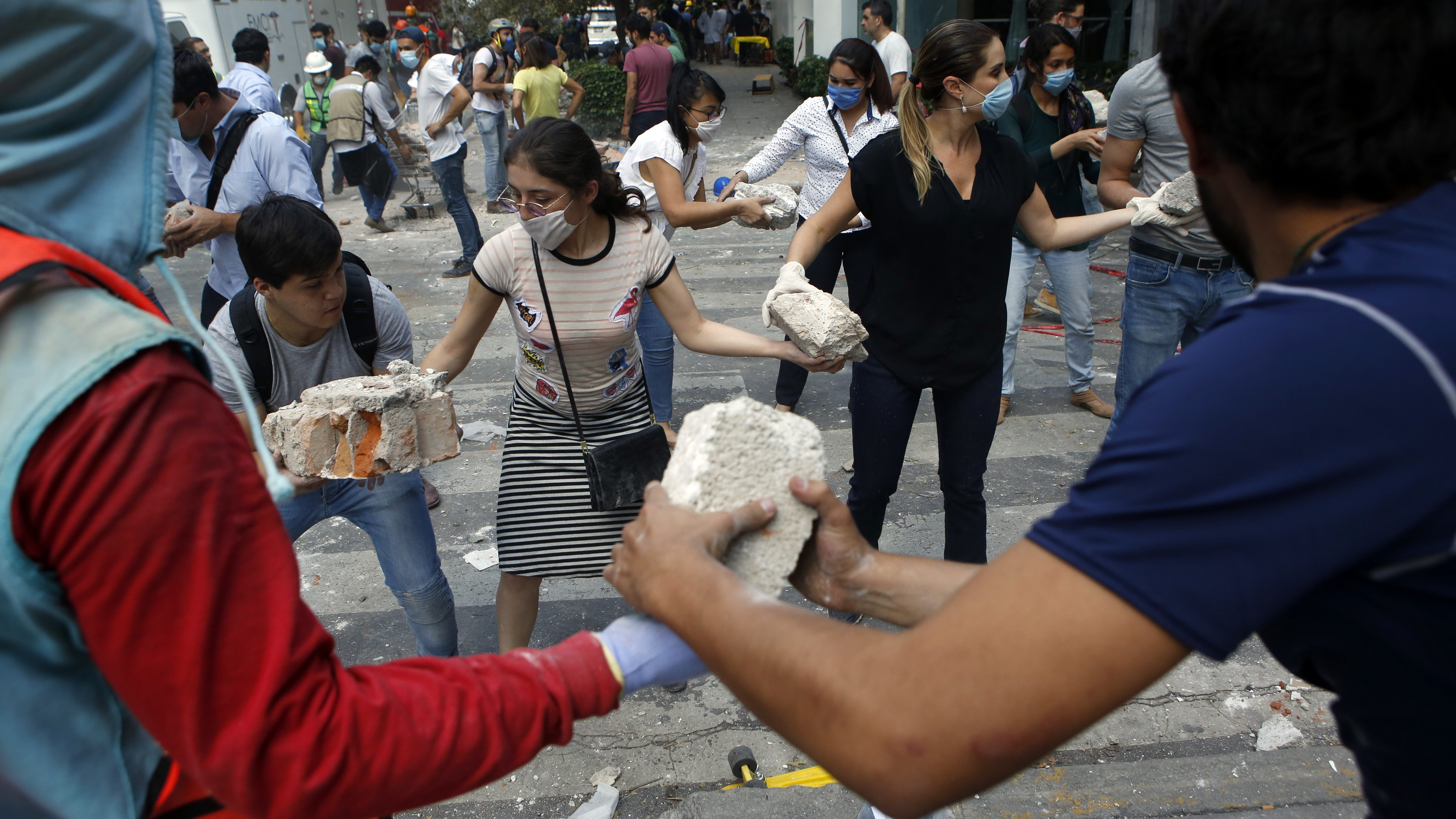 Volunteers pick up the rubble after the sept 19 earthquake in Mexico City