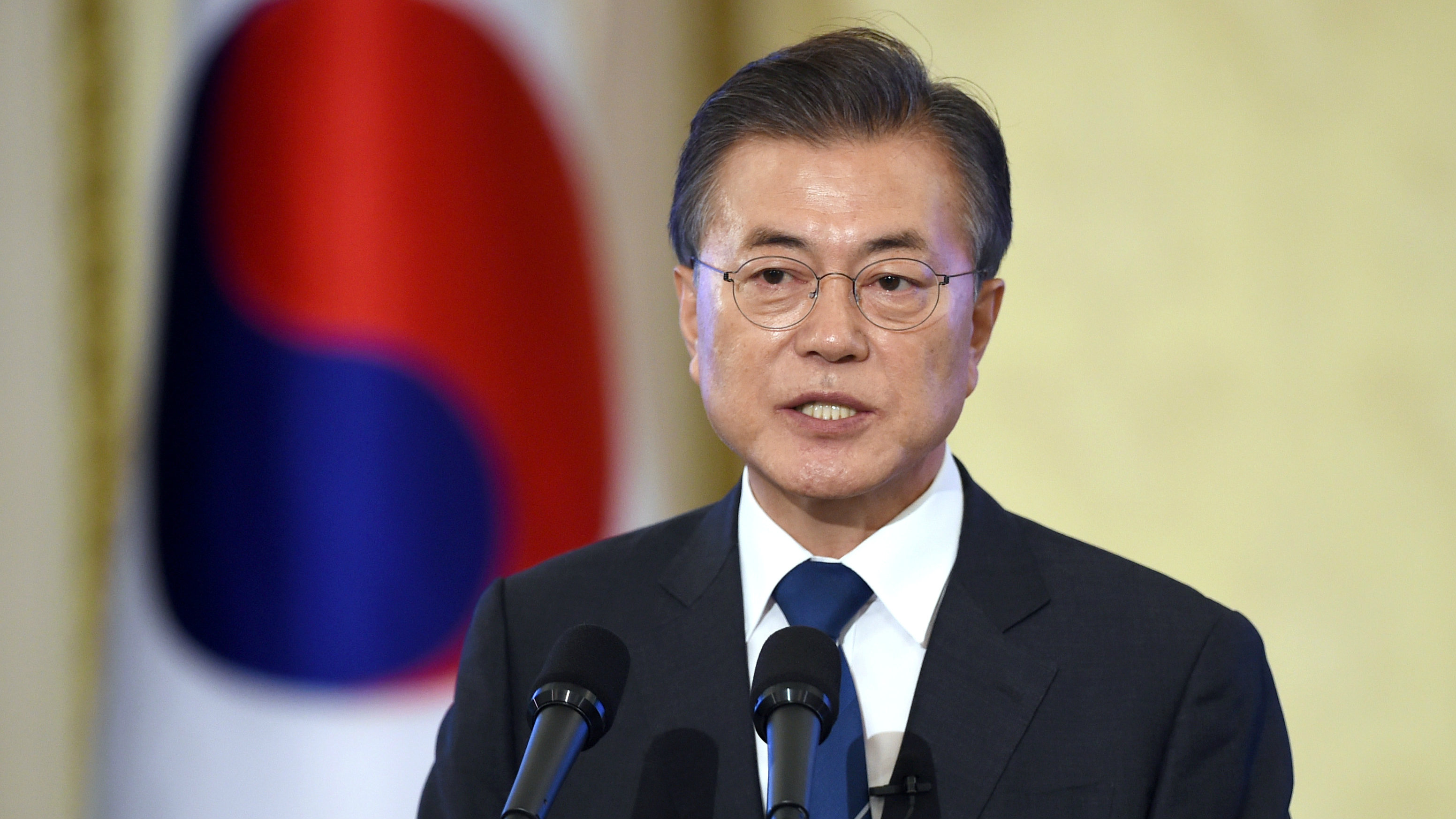 South Korean President Moon Jae-In speaks during a press conference marking his first 100 days in office at the presidential house in Seoul on August 17, 2017.