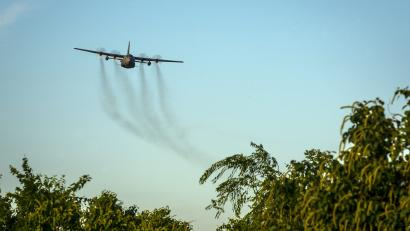 Air force plane spraying insecticide