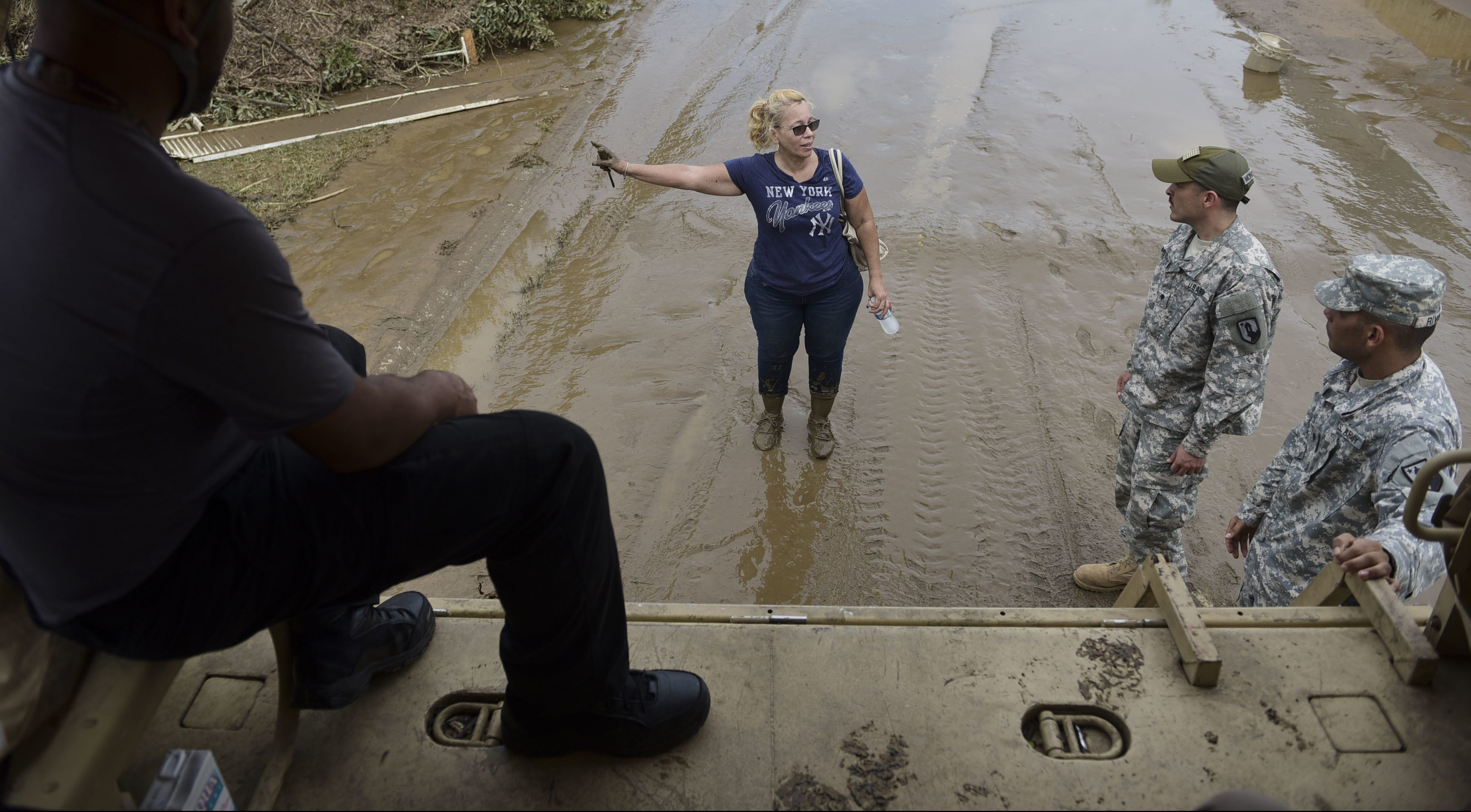 National Guard personnel offer evacuation to a Puerto Rico resident