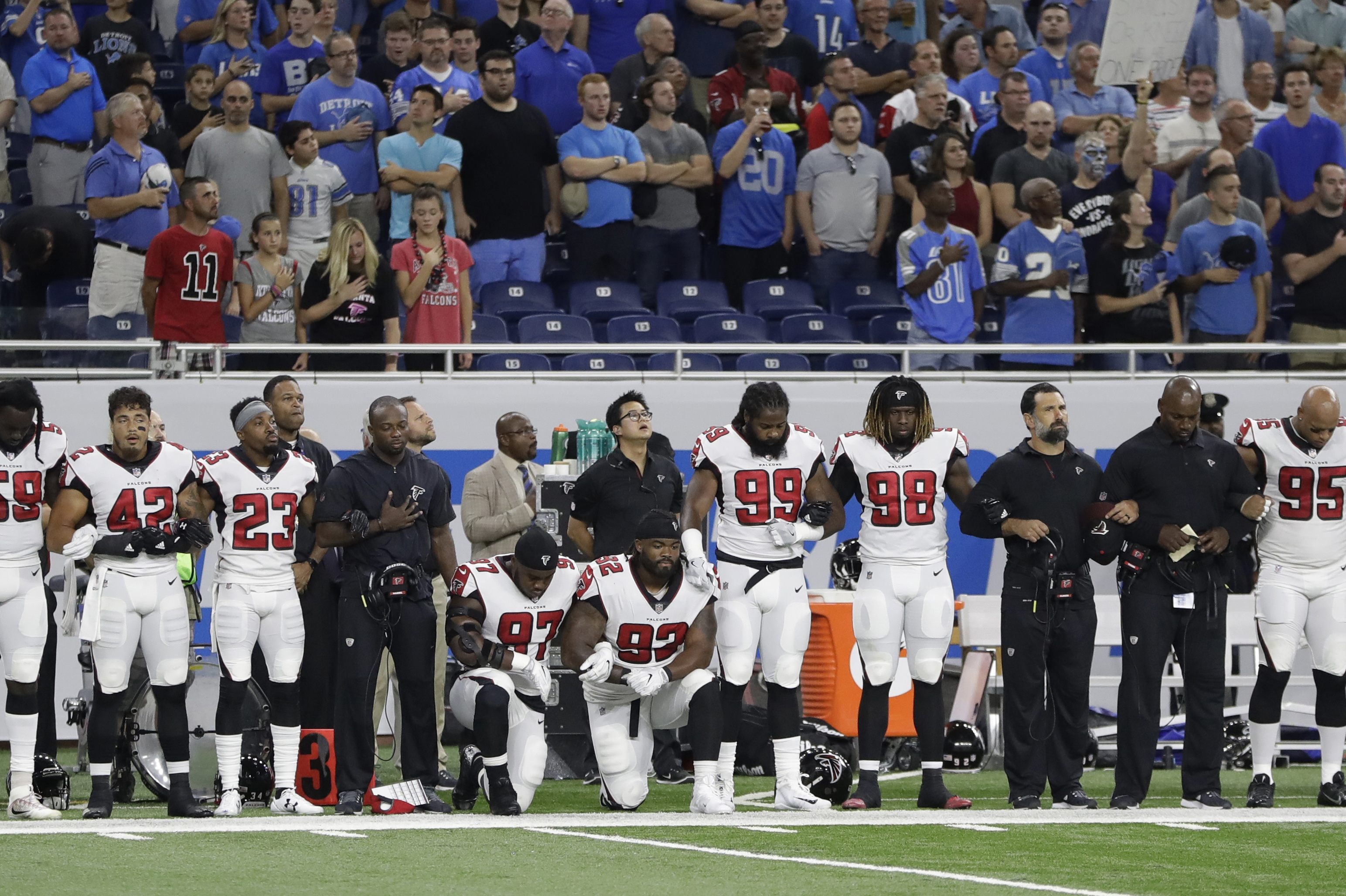 Atlanta Falcons defensive tackles Grady Jarrett (97) and Dontari Poe (92) take a knee during the national anthem before an NFL football game