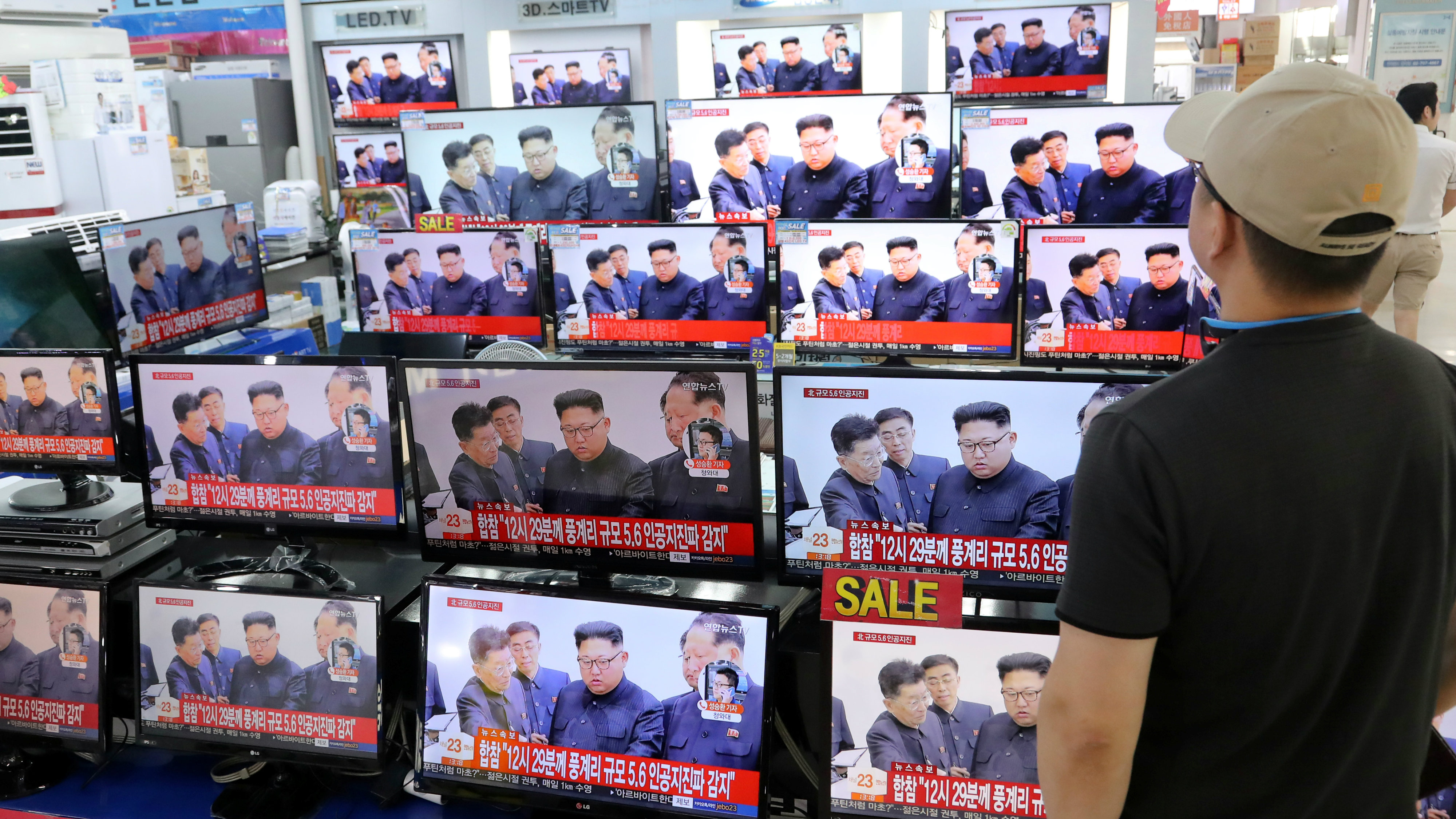 A man watches TV news report about North Korea's nuclear test at an electronic shop in Seoul, South Korea