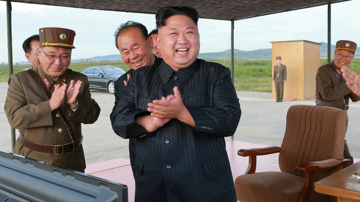 North Korean leader Kim Jong Un guides the launch of a Hwasong-12 missile in this undated photo released by North Korea's KCNA