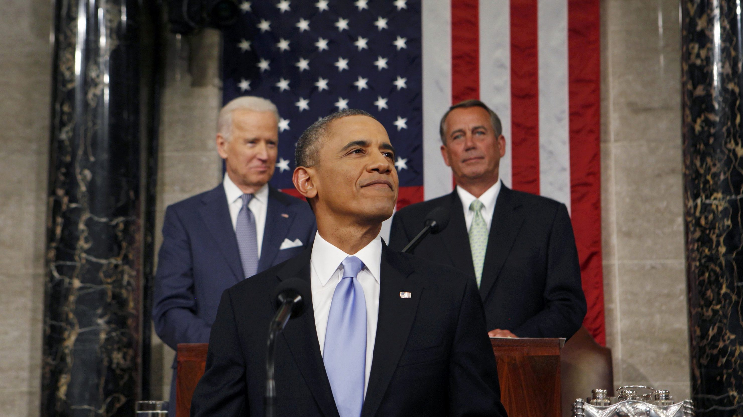 U.S. President Barack Obama smiles as he arrives to deliver his State of the Union speech on Capitol Hill in Washington January 28, 2014.   REUTERS/Larry Downing (UNITED STATES - Tags: POLITICS TPX IMAGES OF THE DAY) - GM1EA1T10IM01