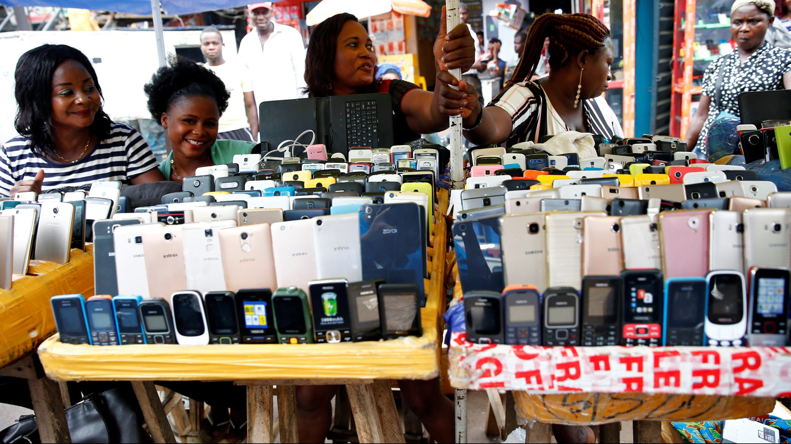 Women vendors display Nokia phone models for sale along with smartphones at the 'Computer Village' in Ikeja district in Nigeria's commercial capital Lagos, Nigeria May 31, 2017.