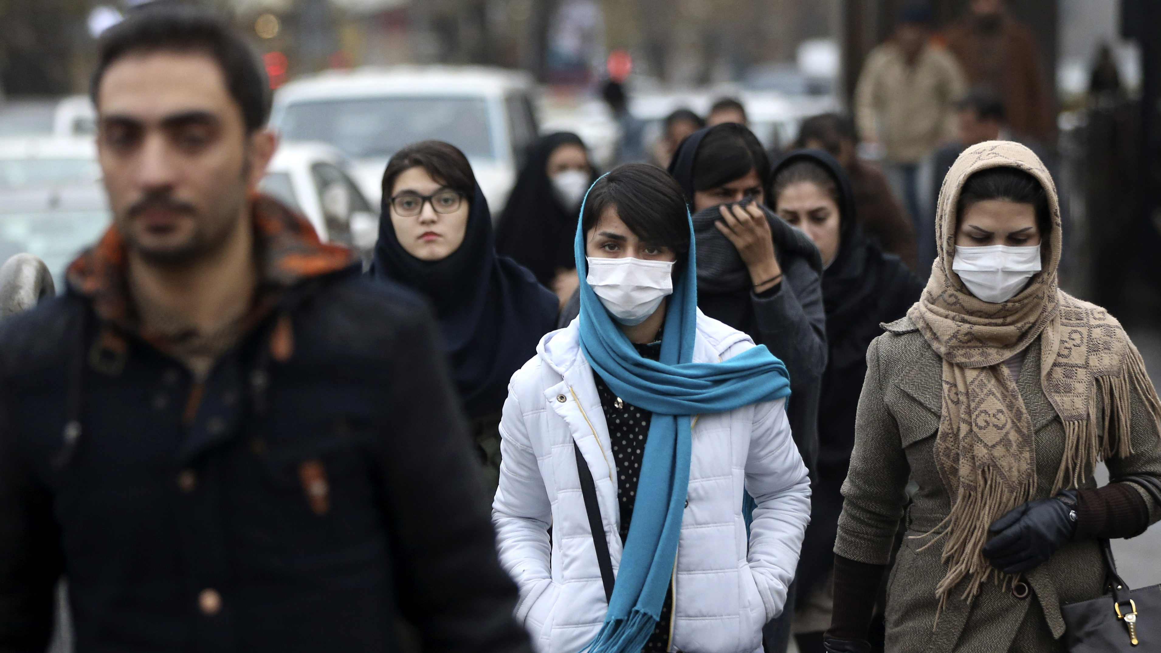 People wearing face masks to block pollution in Iran.