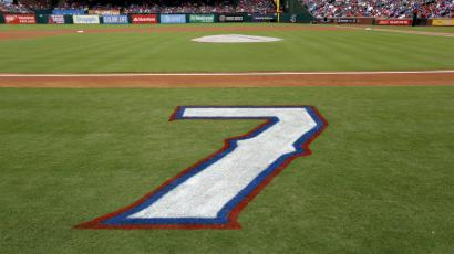The number 7 sprayed on a baseball field.