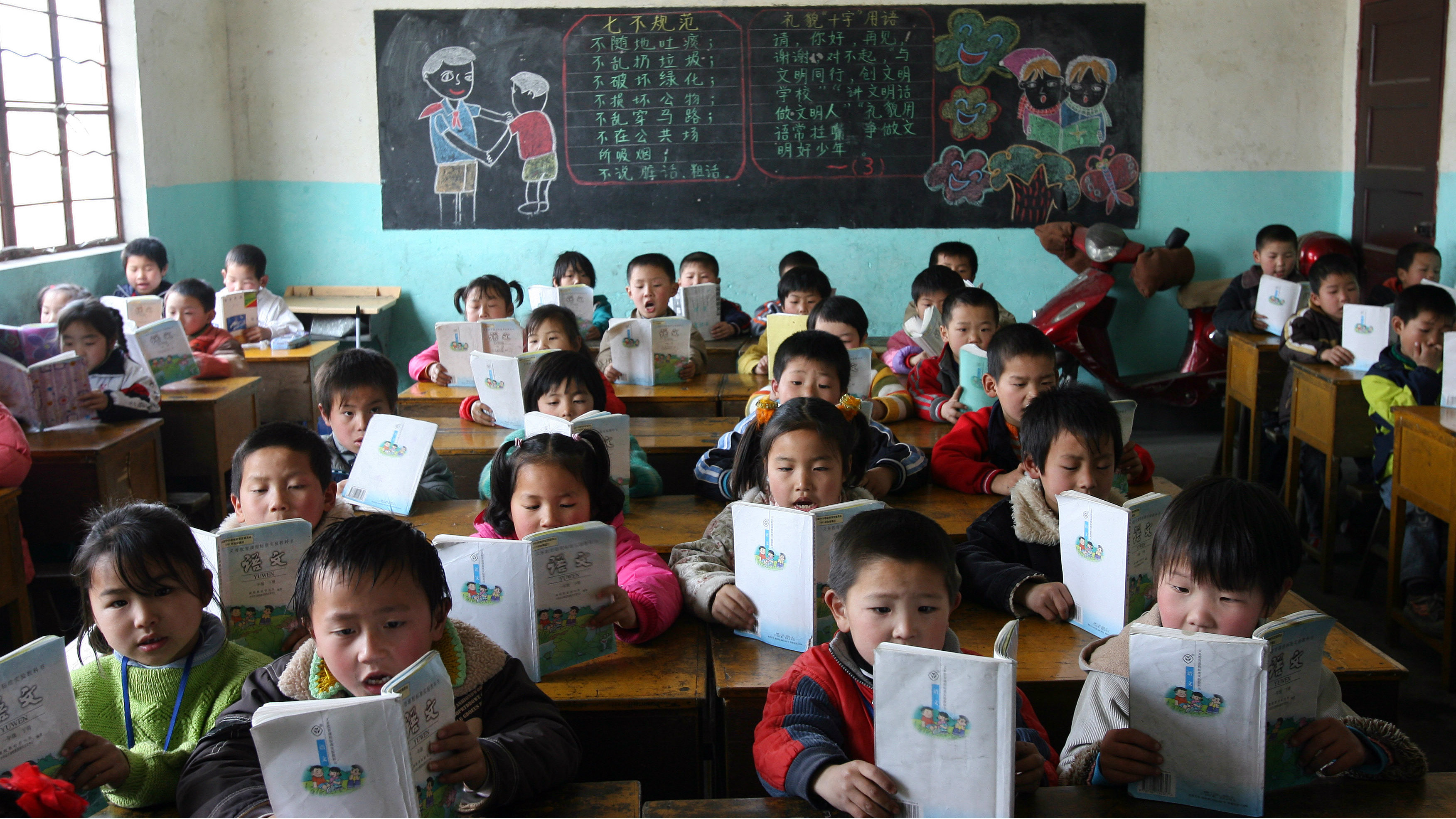 Chinese immigrant workers' children study in their classroom in a rural part of Shanghai