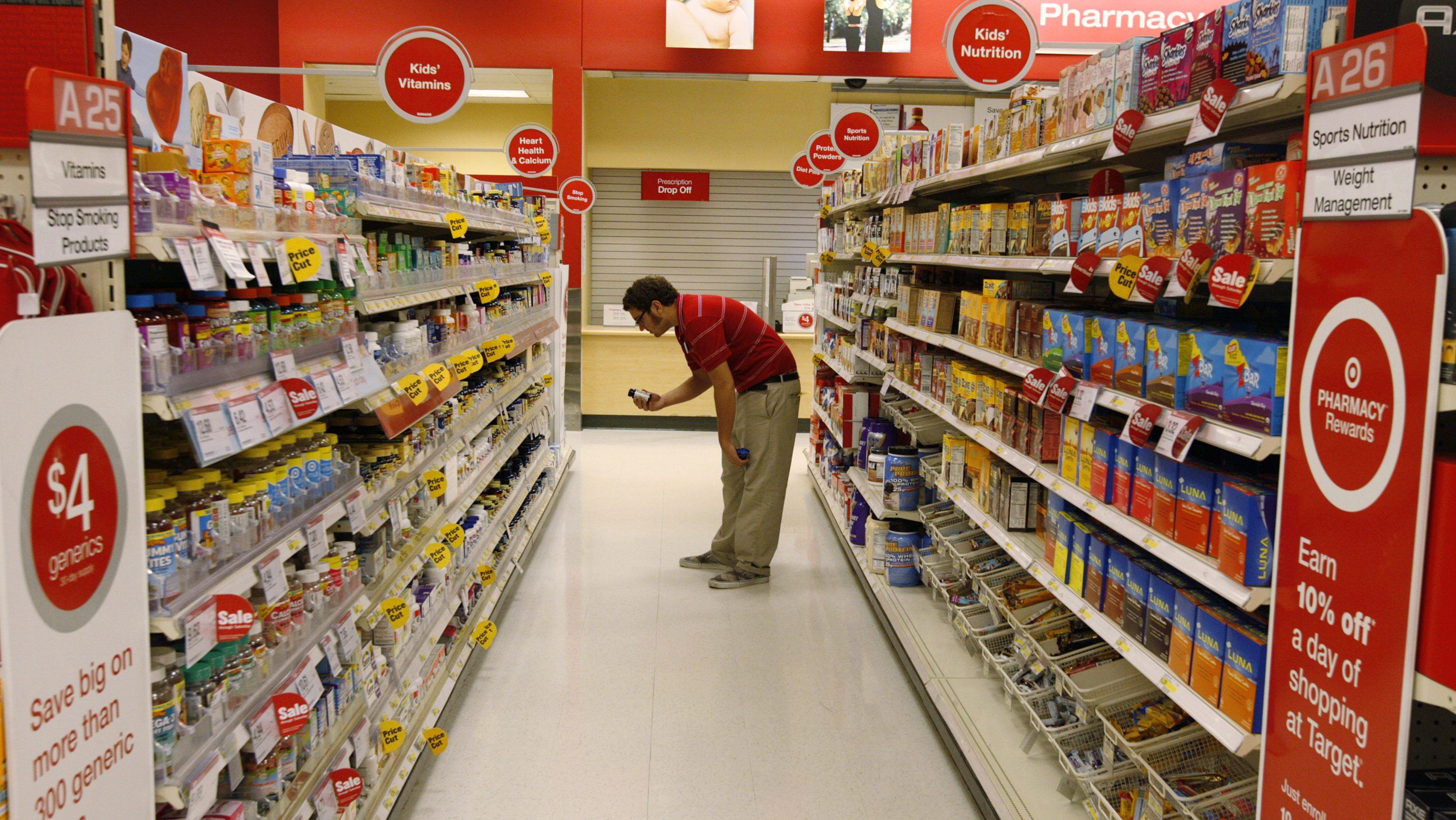 A Target store team member places an item back on the shelf at a Target store in Los Angeles