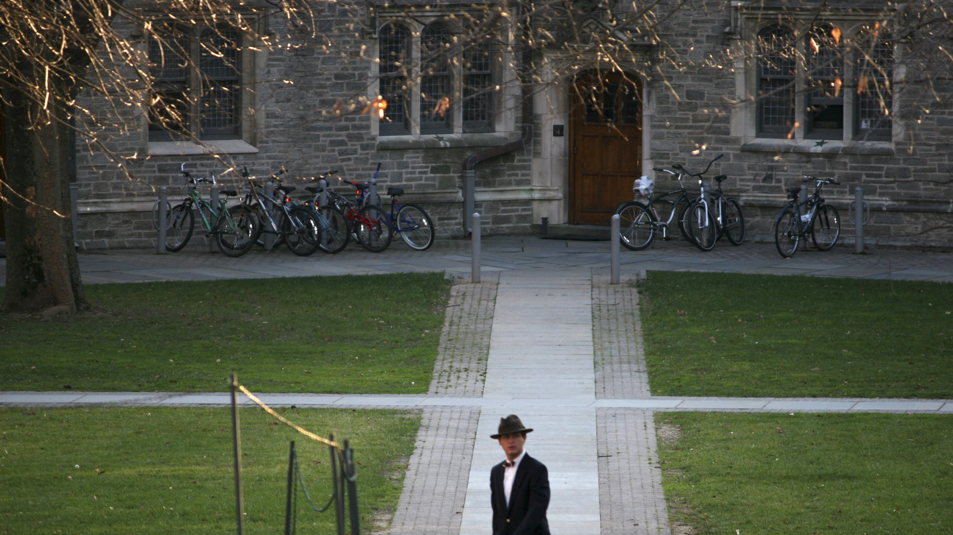 A man walks on the campus of Princeton University in Princeton, New Jersey, November 30, 2009. Reuters correspondents with local knowledge help visitors make the most of a 48-hour visit to Princeton, which is situated 50 miles (80 km) south of New York City and surrounded by fruit and vegetable farms. Picture taken November 30, 2009. To match Reuters Life! TRAVEL-PRINCETON/ REUTERS/Steve James (UNITED STATES - Tags: SOCIETY TRAVEL EDUCATION) - GM1E62Q1MTV01