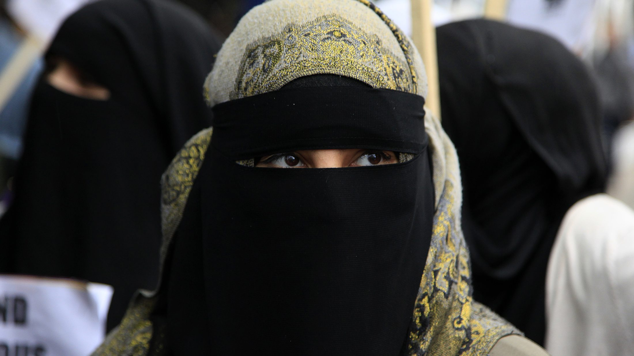 A demonstrator wears a niqab during a protest