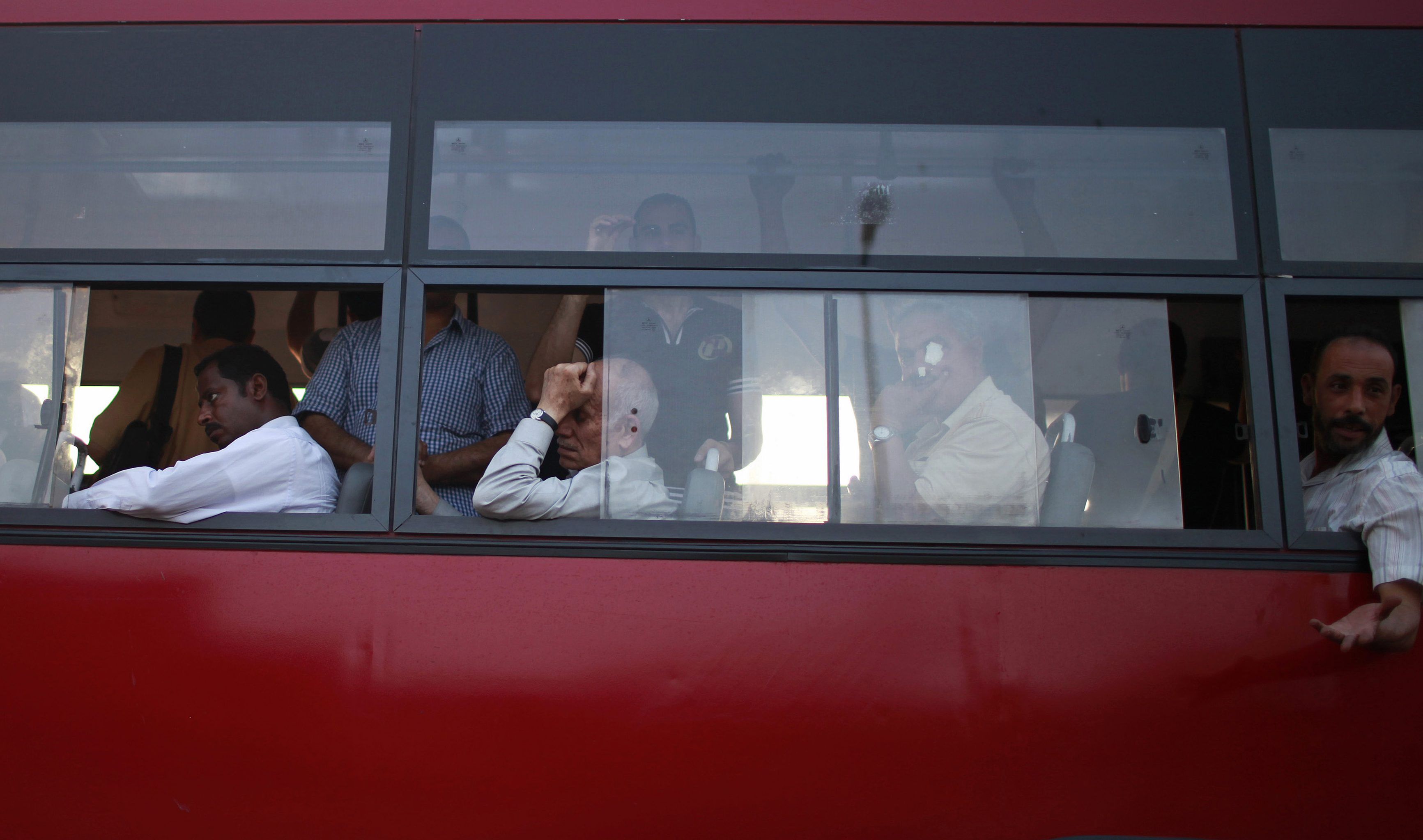 Egyptians ride a bus in Cairo