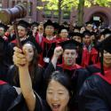 Students from Harvard Law School celebrate as they receive their degrees at Harvard University in Cambridge