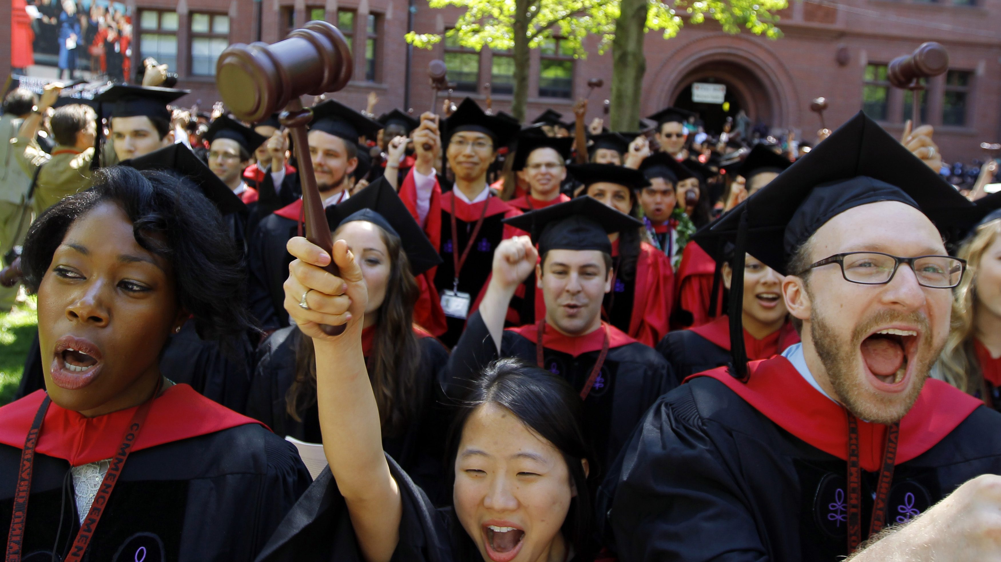 Students from Harvard Law School celebrate as they receive their degrees during the 361st Commencement Exercises at Harvard University in Cambridge, Massachusetts May 24, 2012.       (UNITED STATES - Tags: EDUCATION) - GM2E85P044H01