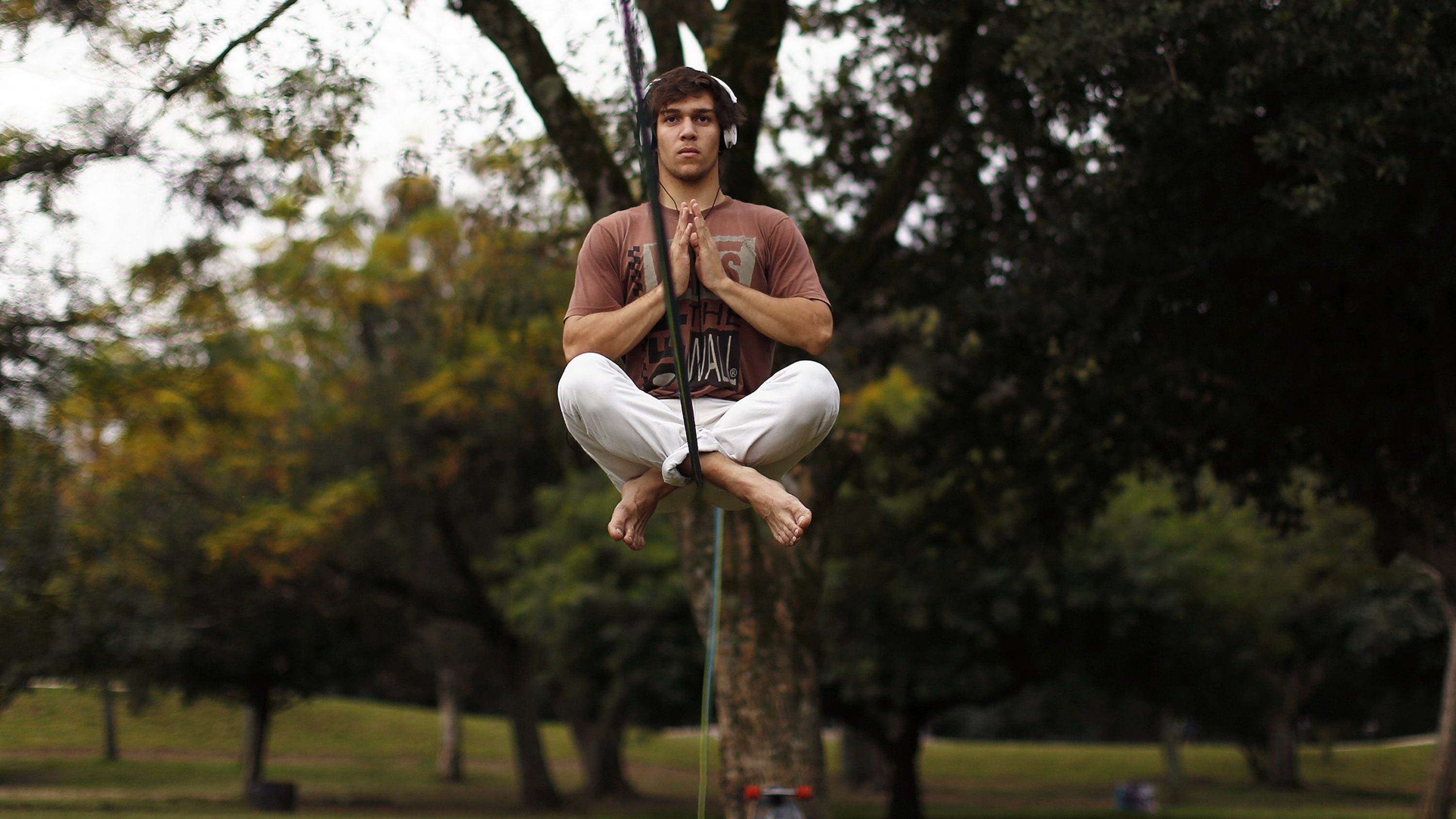 Vitor Haas concentrates as he sits on a rope before tightrope walking near the Beira-Rio stadium in Porto Alegre June 16, 2014. In a project called 'On The Sidelines' Reuters photographers share pictures showing their own quirky and creative view of the 2014 World Cup in Brazil.