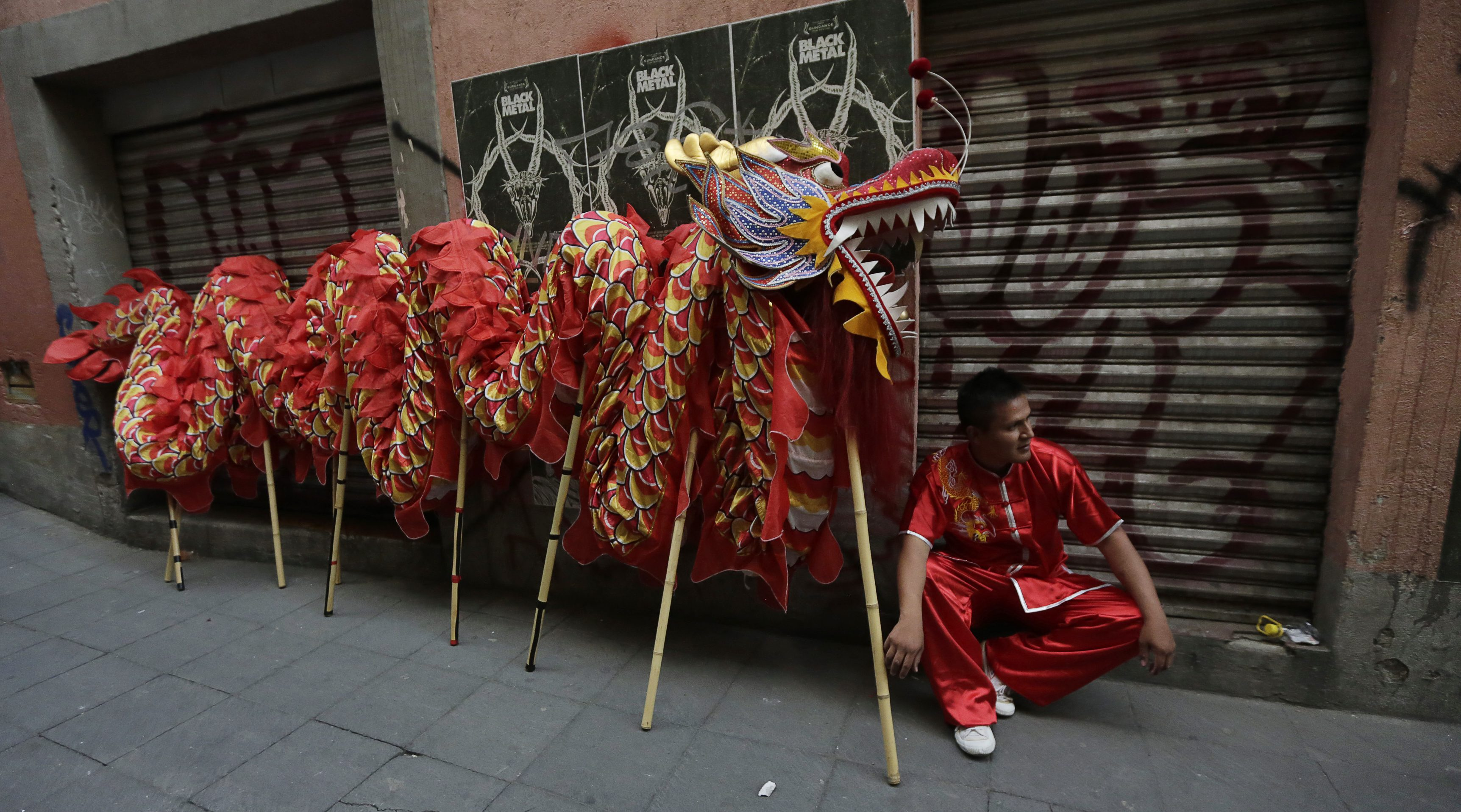 An artist sits next to a Chinese dragon before he performs a traditional Chinese dragon dance during Lunar New Year celebrations in Chinatown in Mexico City February 20, 2015.
