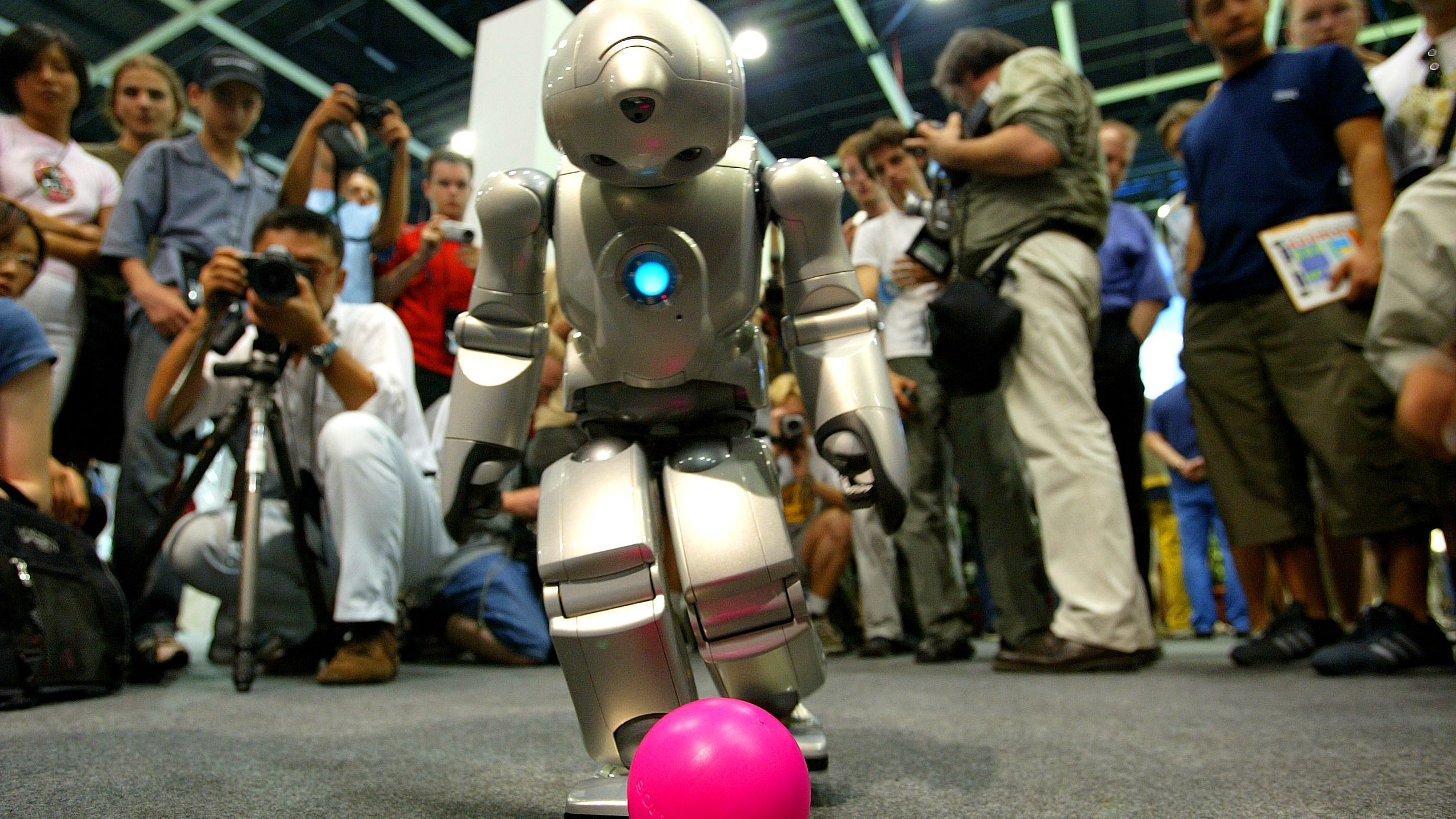 A humanoid robot tries to kick the ball during a demonstation at the 7th edition of the Soccer World Championship for Robots in Padua, northern Italy, July 9, 2003. Robocup is an international research and education initiative and its goal is to foster artificial intelligence and robotics research by providing a standard problem where a wide range of technologies can be examined and integrated. REUTERS/Max Rossi