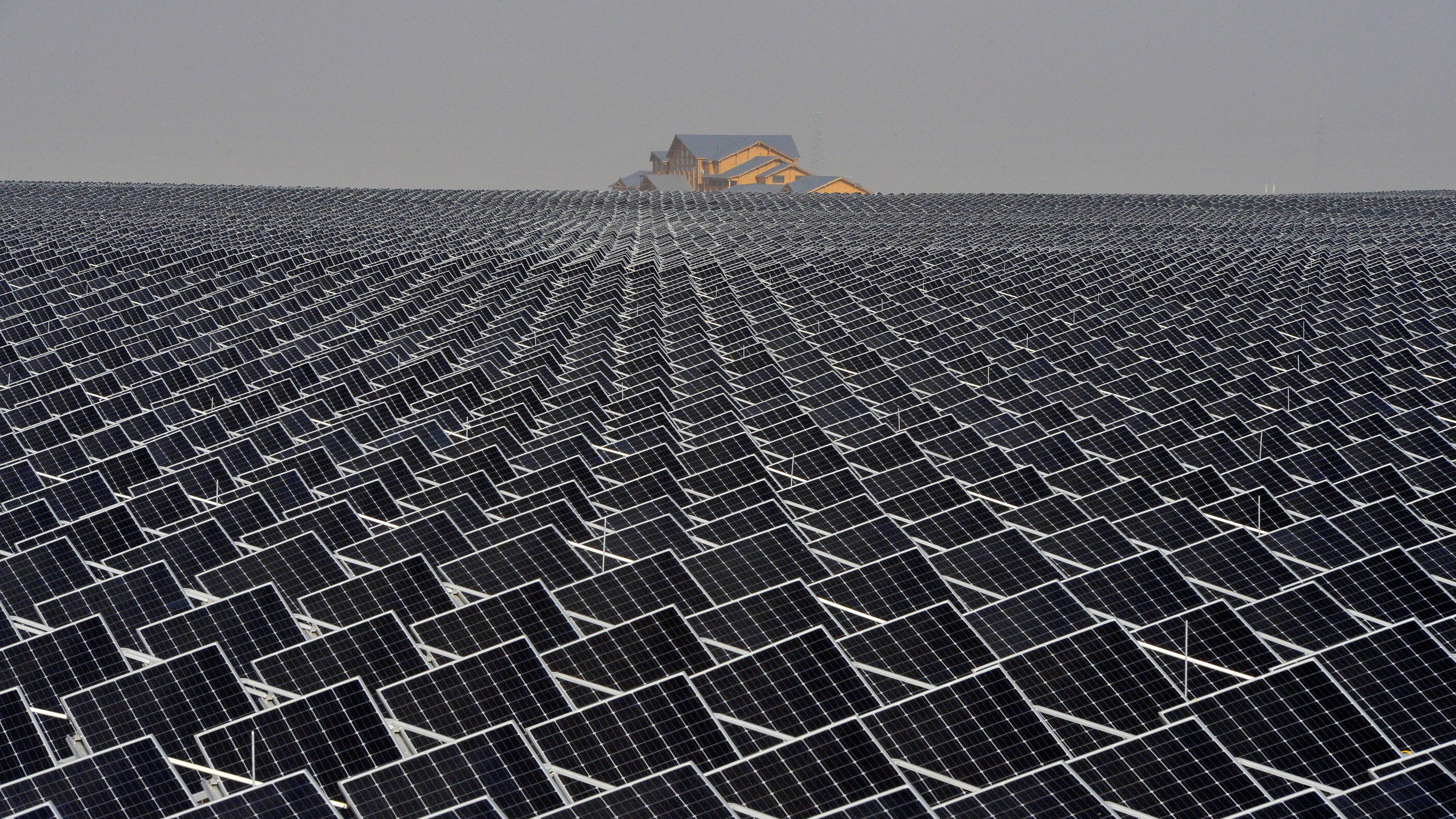 Solar panels are seen in Yinchuan, Ningxia Hui Autonomous Region, China April 18, 2017.