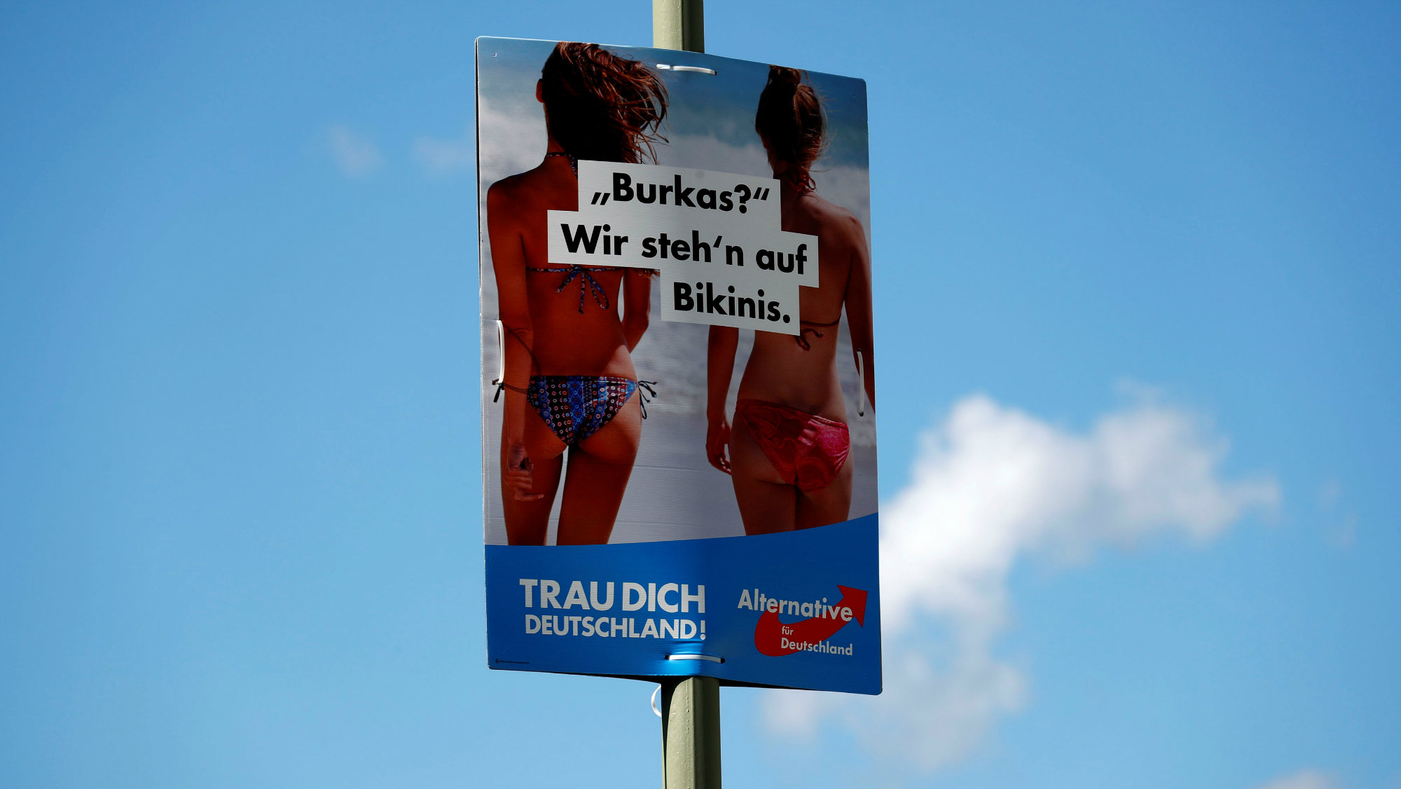 "An election campaign poster for the upcoming general elections of the anti-immigration party Alternative for Germany (AFD) is pictured in Berlin, Germany, August 23, 2017. The poster reads ""Burqa? We like bikinis."""