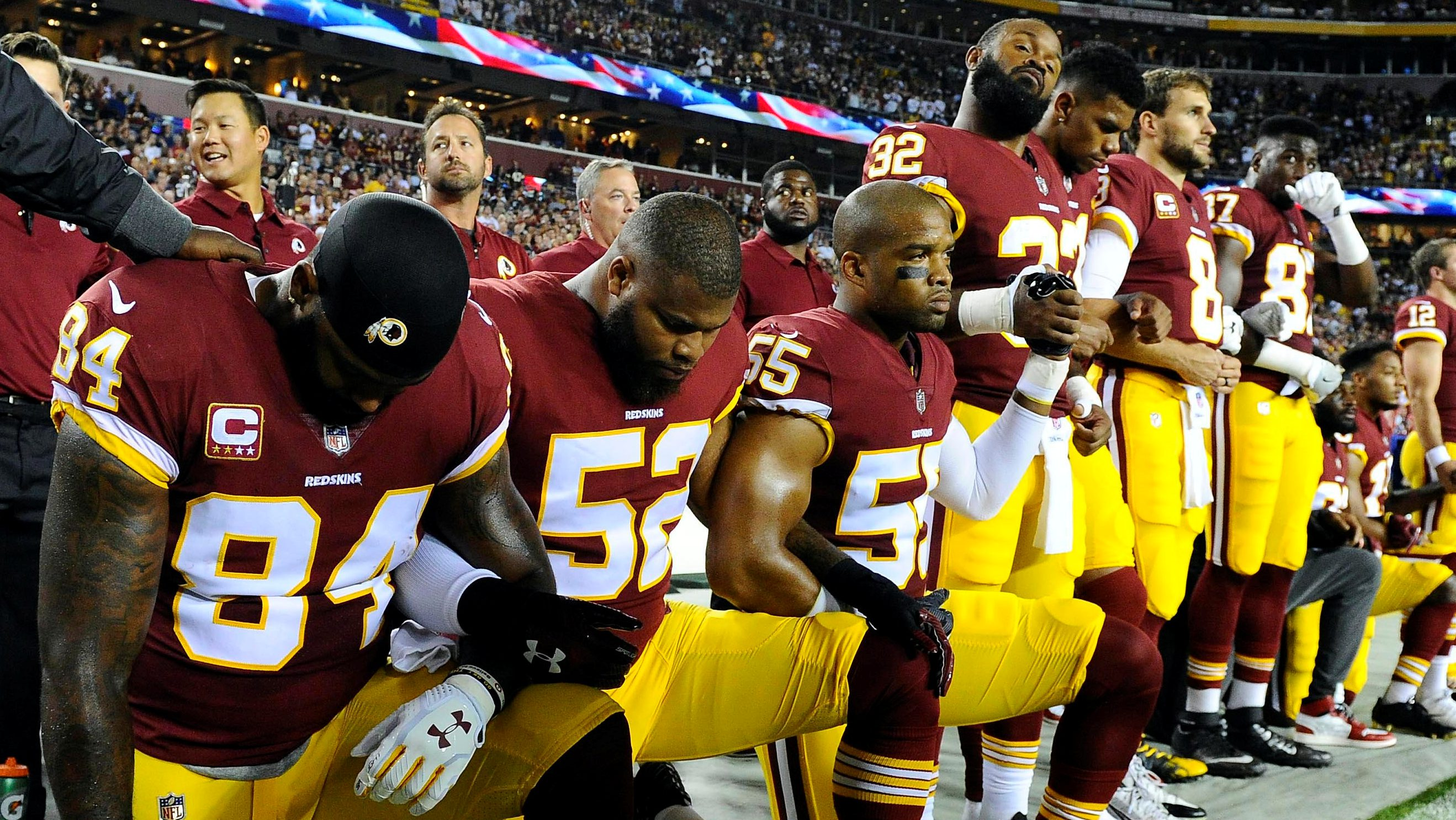 Sep 24, 2017; Landover, MD, USA; Washington Redskins tight end Niles Paul (84) and linebacker Ryan Anderson (52) and Washington Redskins linebacker Chris Carter (55) kneel with teammates during the playing of the national anthem before the game between the Washington Redskins and the Oakland Raiders at FedEx Field. Mandatory Credit: Brad Mills-USA TODAY Sports     TPX IMAGES OF THE DAY - 10305289